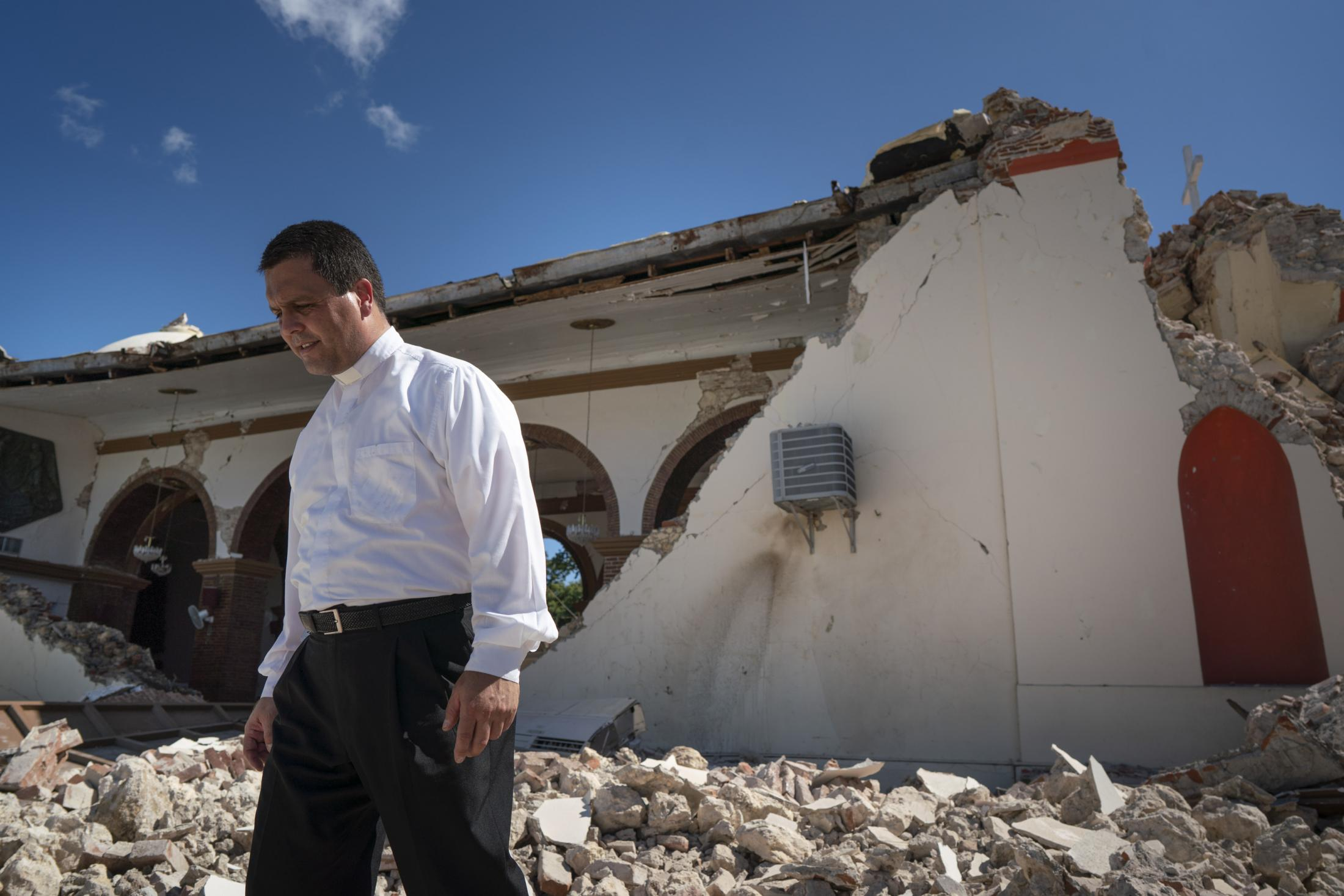 GUAYANILLA, PUERTO RICO - JANUARY 7: The father inspect damage to the church Parroquia Inmaculada Concepción after a 6.4 earthquake hit just south of the island January 7, 2020 on Guayanilla, PR. This morning's earthquake was preceded by a series of smaller quakes in the south of the island with epicentric in Guánica. (Photo by Eric Rojas/Getty Images)