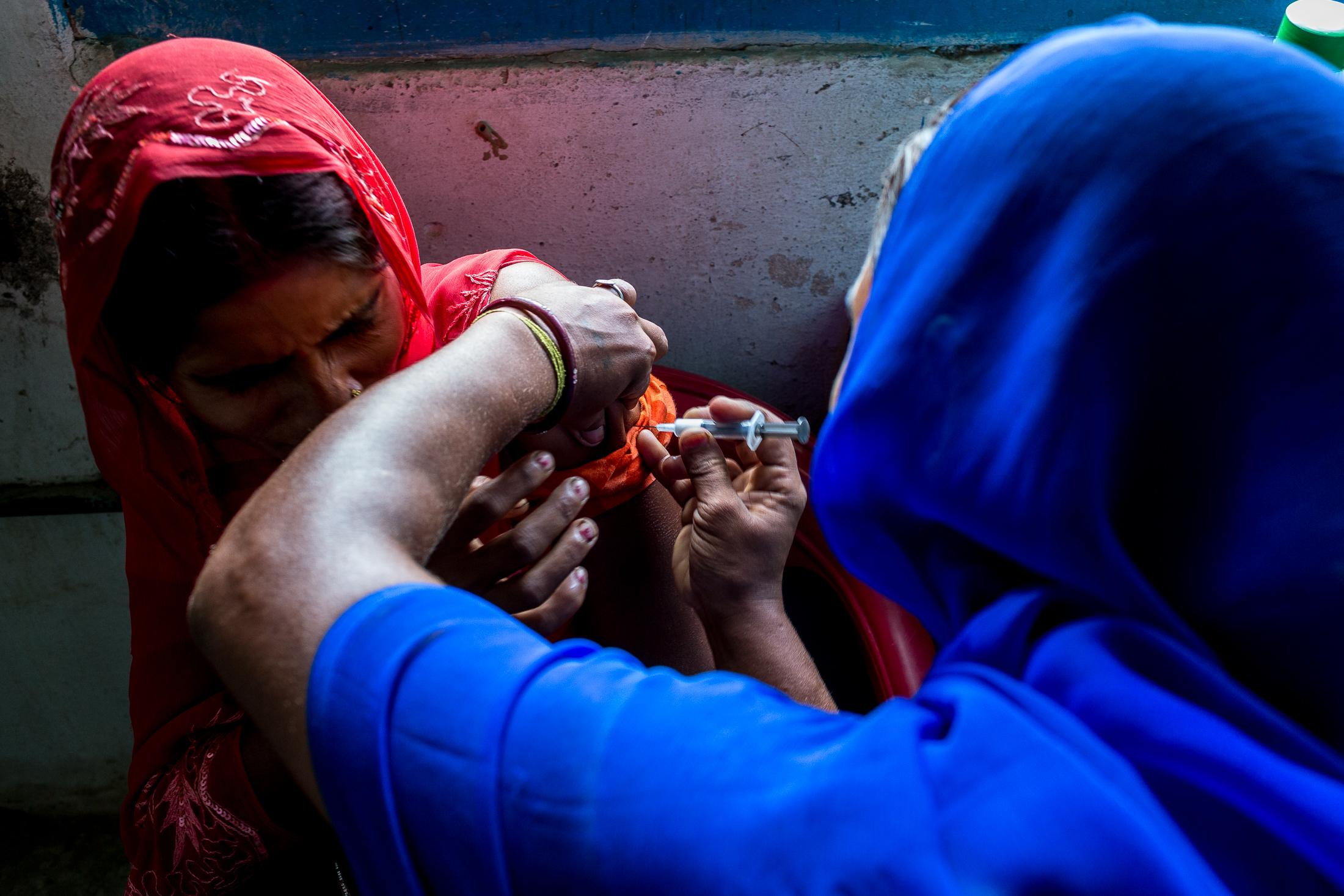 JANAKPUR, NEPAL - JULY 23: A young Maithil woman receives an injection in her arm from a Maithil woman working as a nurse in a local clinic in a remote village on July 23, 2015 near Janakpur, Nepal. Photo: © Omar Havana