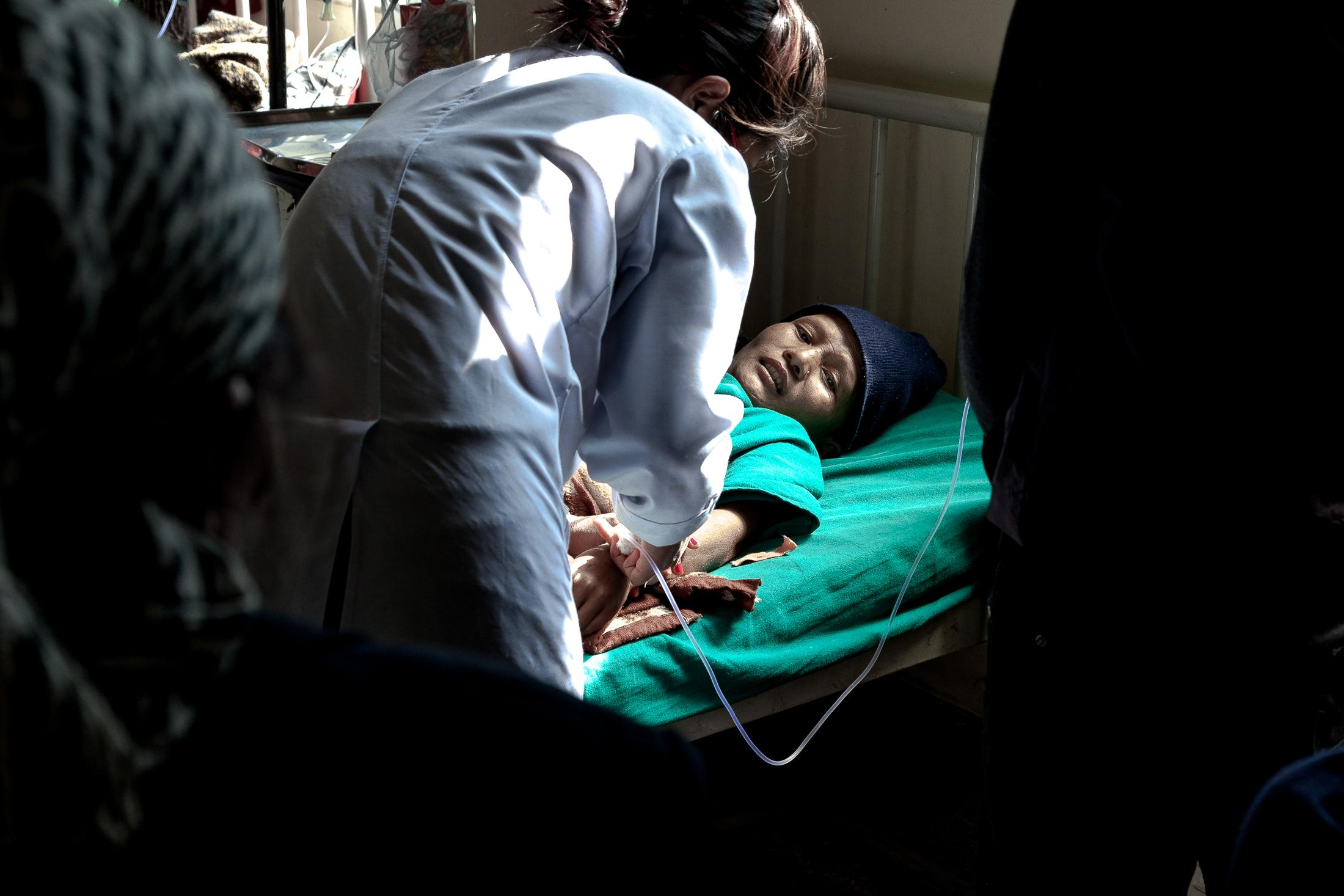 BHAKTAPUR, NEPAL- FEBRUARY 02: A patient affected by cervical cancer lays on a hospital bed while receiving chemotherapy at the Bhaktapur Cancer Hospital on February 02, 2015 in Bhaktapur, Nepal. More than 1,100 women die from cervical cancer in Nepal each year, making it the most common cancer among women in the country. Despite being easily preventable, the lack of awareness around screening has made this form of cancer one of the most prevalent in the developing world. Photo: © Omar Havana
