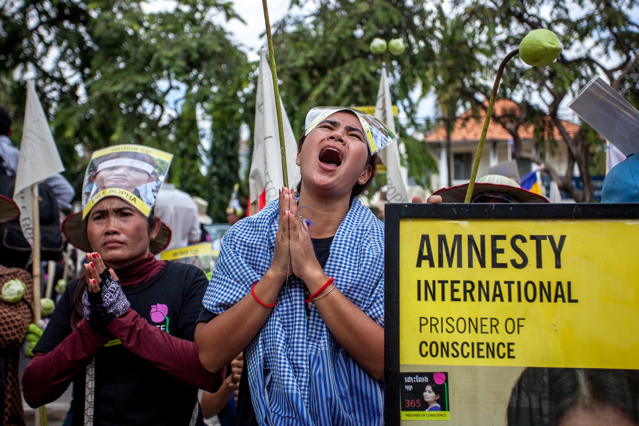 PHNOM PENH, CAMBODIA - September 10: Boeung Kak Lake activist Tep Vanny cries during a demonstration demanding the release of Amnesty International Prisoner of Conscience and fellow Boeung Kak Lake activist Yorm Bopha in Phnom Penh, Cambodia on September 10, 2013. Since Boeung Kak Lake was leased to a private company in 2007, resulting in the evictions of surrounding communities in 2009, a group of women from the Lake has taken the forefront of the fight for their rights. Although their activism was initially dedicated to saving their homes, they are now some of Cambodia's most well-known, outspoken and fearless activists, becoming an iconic symbol of the fight of human rights and justice in Cambodia. Photo: © Omar Havana