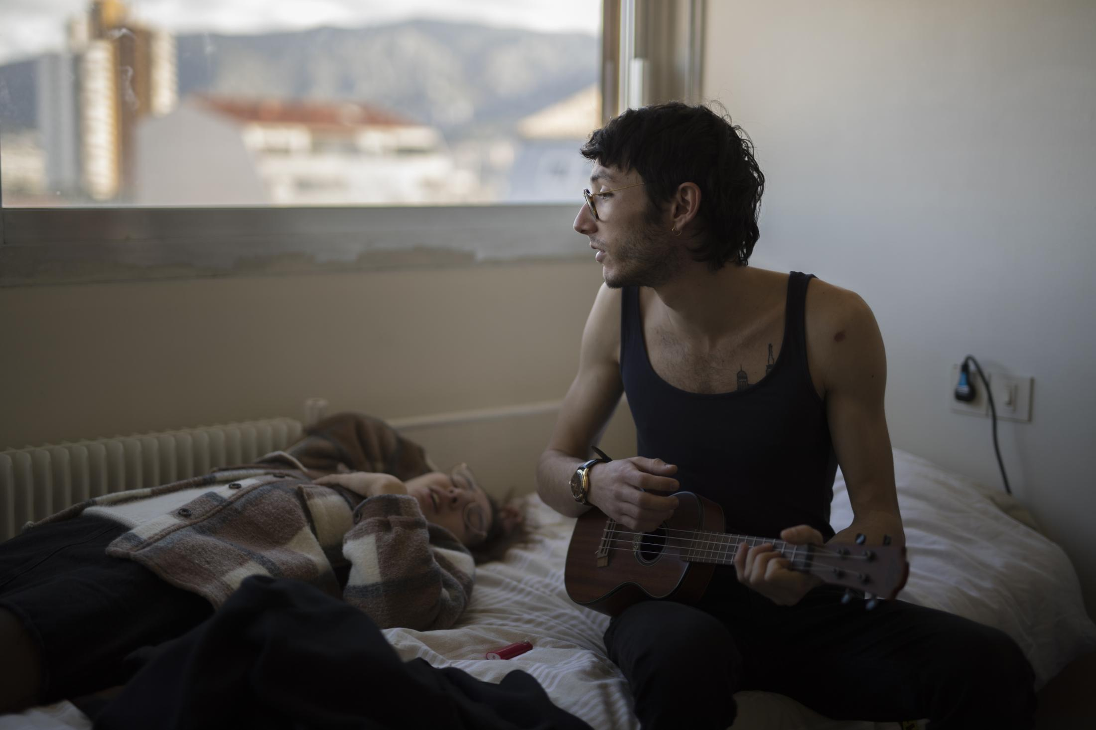 Vincent Achour, a hospital intern in psychiatry and his sister Pauline sing along together to a ukelele on the 8th floor of the intern residency of Marseille's La Timone hospital, Dec 15, 2019.