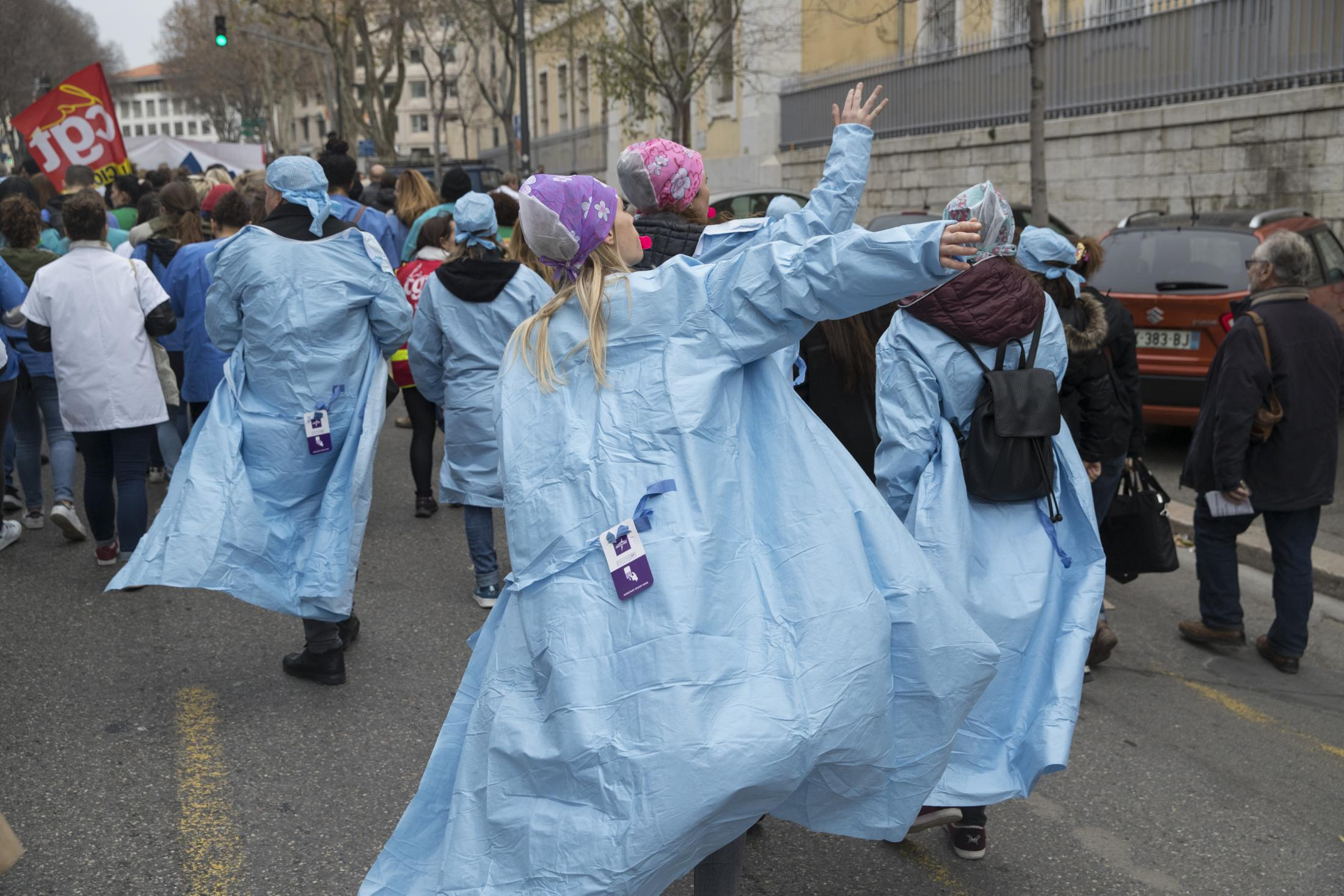 Hospital workers march in Marseille, southern France, Tuesday, Dec. 17, 2019.