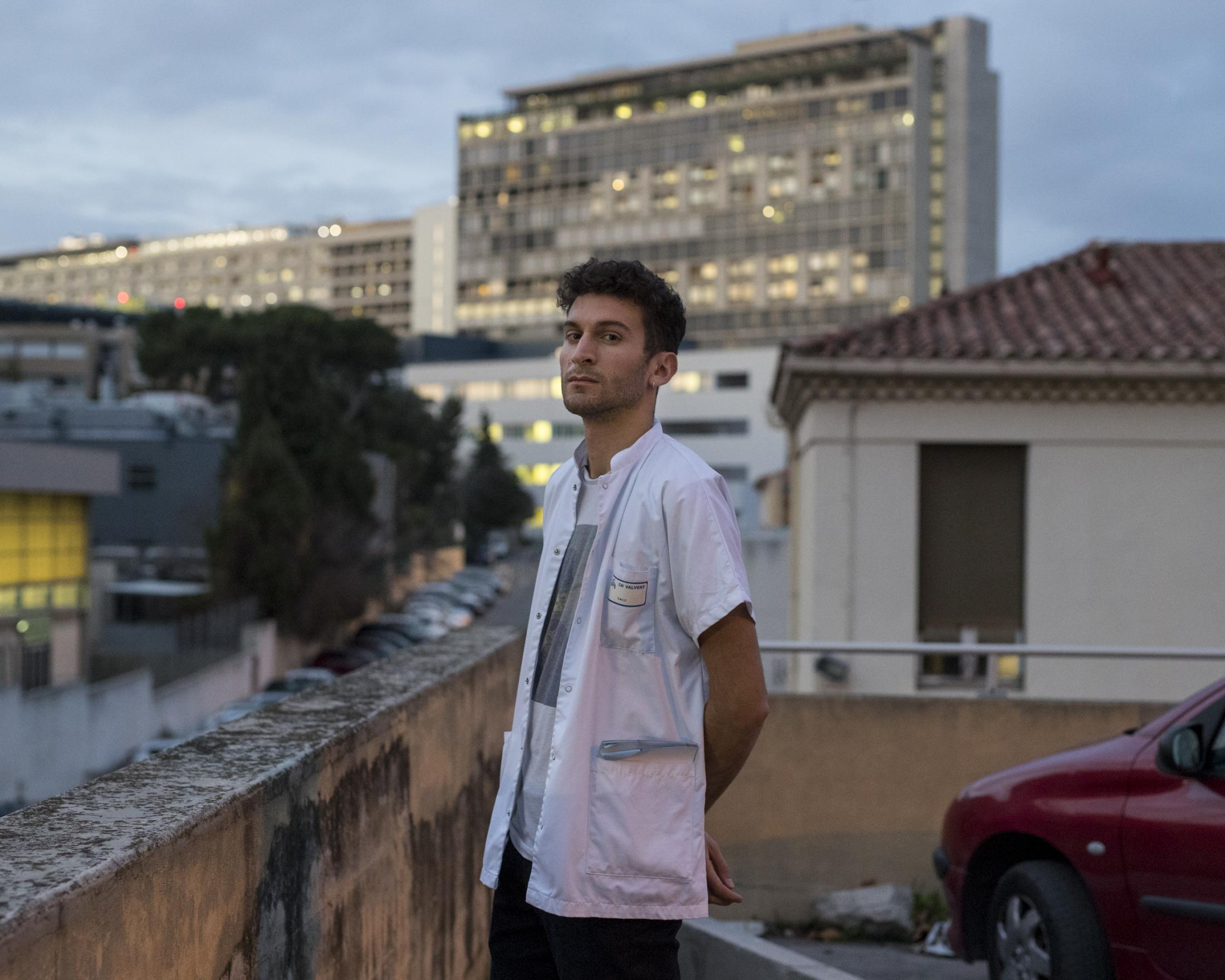 Nathan Demerl, a psychiatry intern on strike poses for a portrait in front of Marseille's La Timone hospital, Dec. 16, 2019.