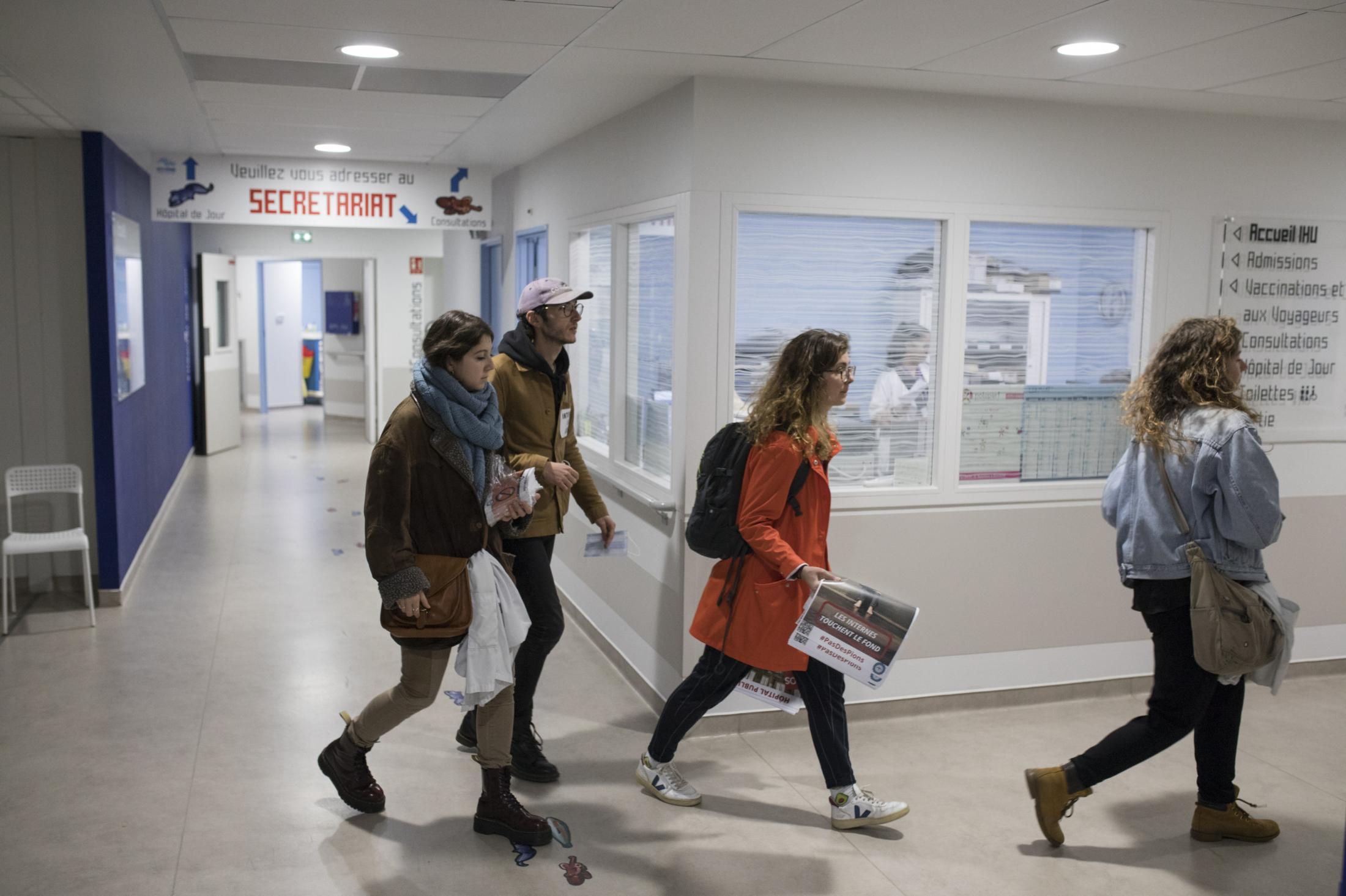 Interns of the Autonomous Union for Interns of the Hospitals of Marseille canvass La Timone hospital with pamphlets and posters, looking to inform interns on shift about their working rights. Dec 16, 2019.