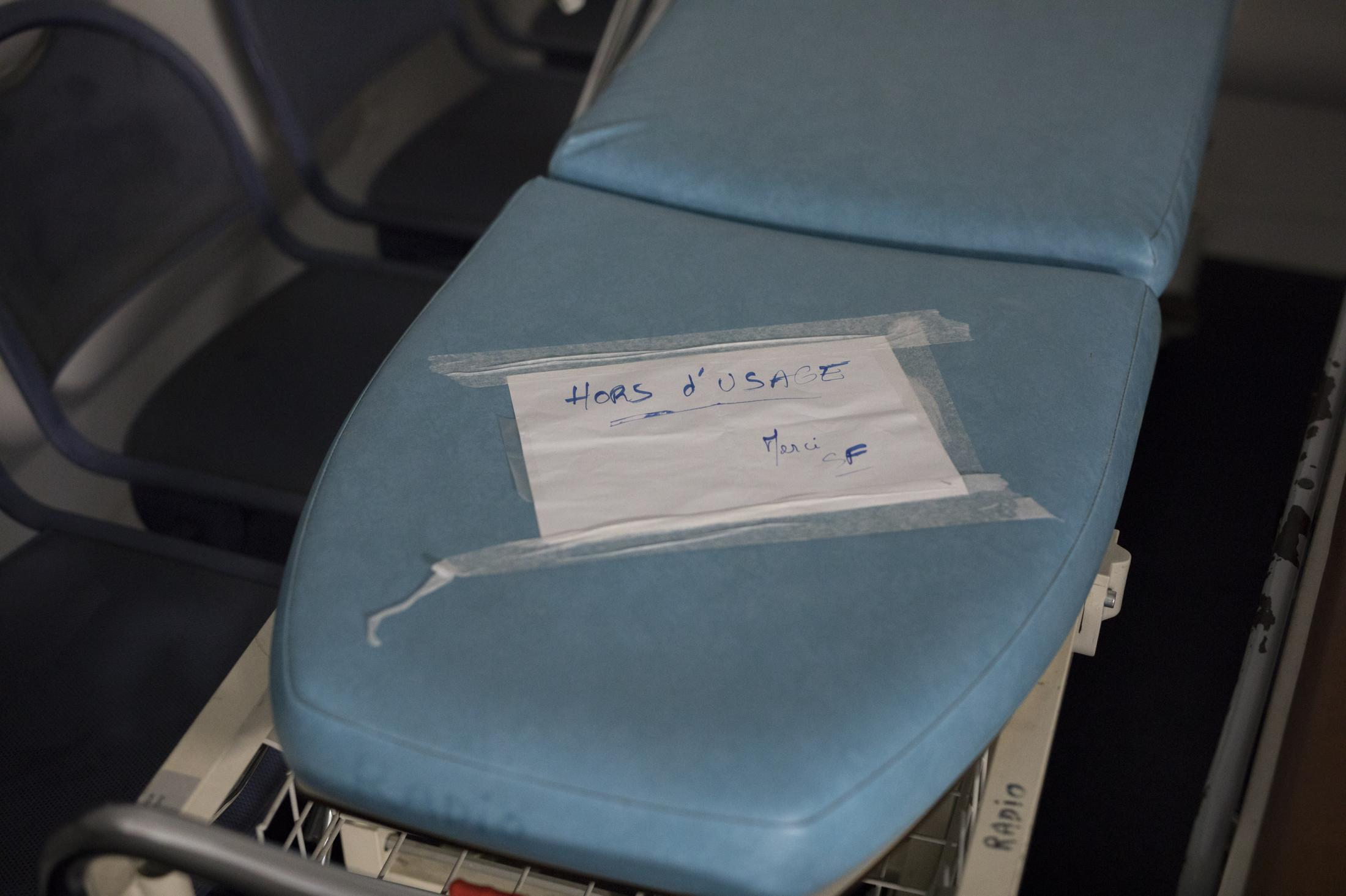 "A sign reads ""out of service, thank you"" on a gurney in Marseille's Hospital de la Conception. Dec. 19, 2019."
