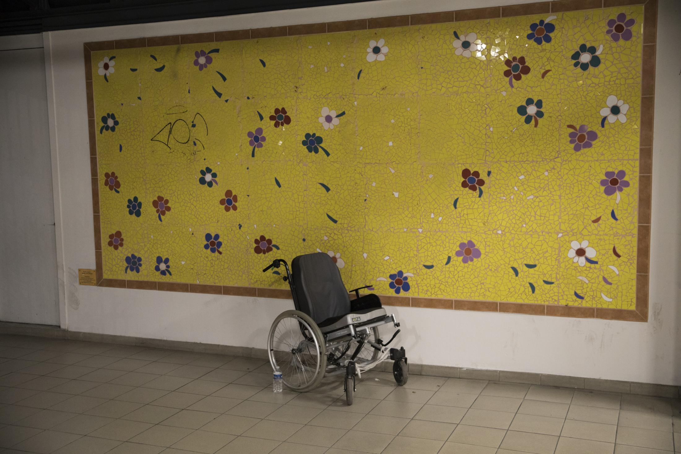 An empty wheelchair sits at the entrance to La Timone hospital in Marseille, southern France, Dec. 9, 2019