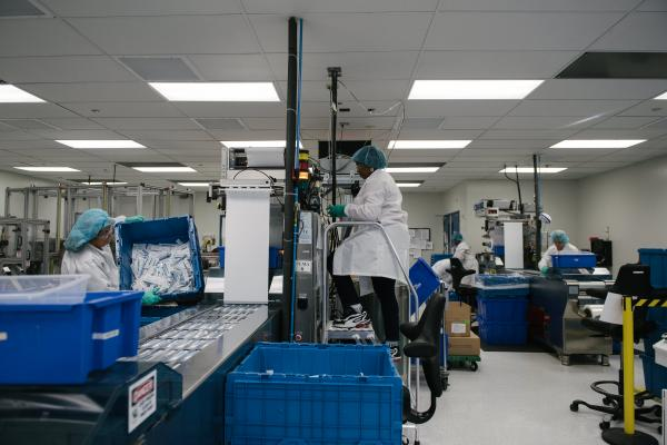 Workers put together oral testing kits at the OraSure Technologies plant in Bethlehem, PA on Wednesday, December 11, 2019. OraSure develops and manufactures medical devices such as the OraQuick testing kit, the first over-the-counter home HIV test. Hannah Yoon