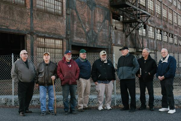 Former Bethlehem Steel workers, left to right, John Weiss, Lester Clore, Joe Mayer, Donald Stuart Young, Mike Dzwonczyk, Tom Sedor, Ron Ennis, and Mike Pron, stand in front of an old Bethlehem Steel building in Bethlehem, PA on Thursday, December 12, 2019. Hannah Yoon