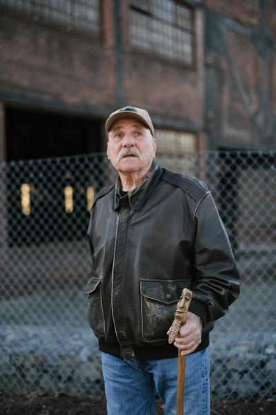 Lester Clore, 77, a former Bethlehem Steel worker, stands for a portrait in front an old Bethlehem Steel building in Bethlehem, PA on Thursday, December 12, 2019. Hannah Yoon