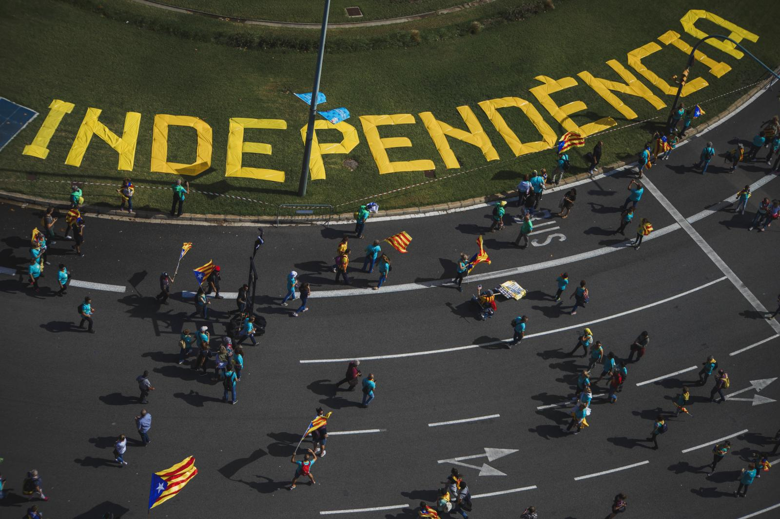 """People walking with symbols and flags for independence during the Catalan National day known as """"la Diada"""" celebrated on September 11th every year to commemorate the loss of Catalonia's laws and institutions after the Siege of Barcelona in 1714. More and more divided after the attempted secession of 2017, the Catalan independentists have measured their forces in the Catalan capital in the least participation in the last eight years, a few weeks before the Supreme Court ruling after the trial of the procés. The Guàrdia Urbana of Barcelona estimates that some 600,000 people have attended, less than any other year since 2012 when massive independence protests began. (September 11,2019. Barcelona, Spain)"""