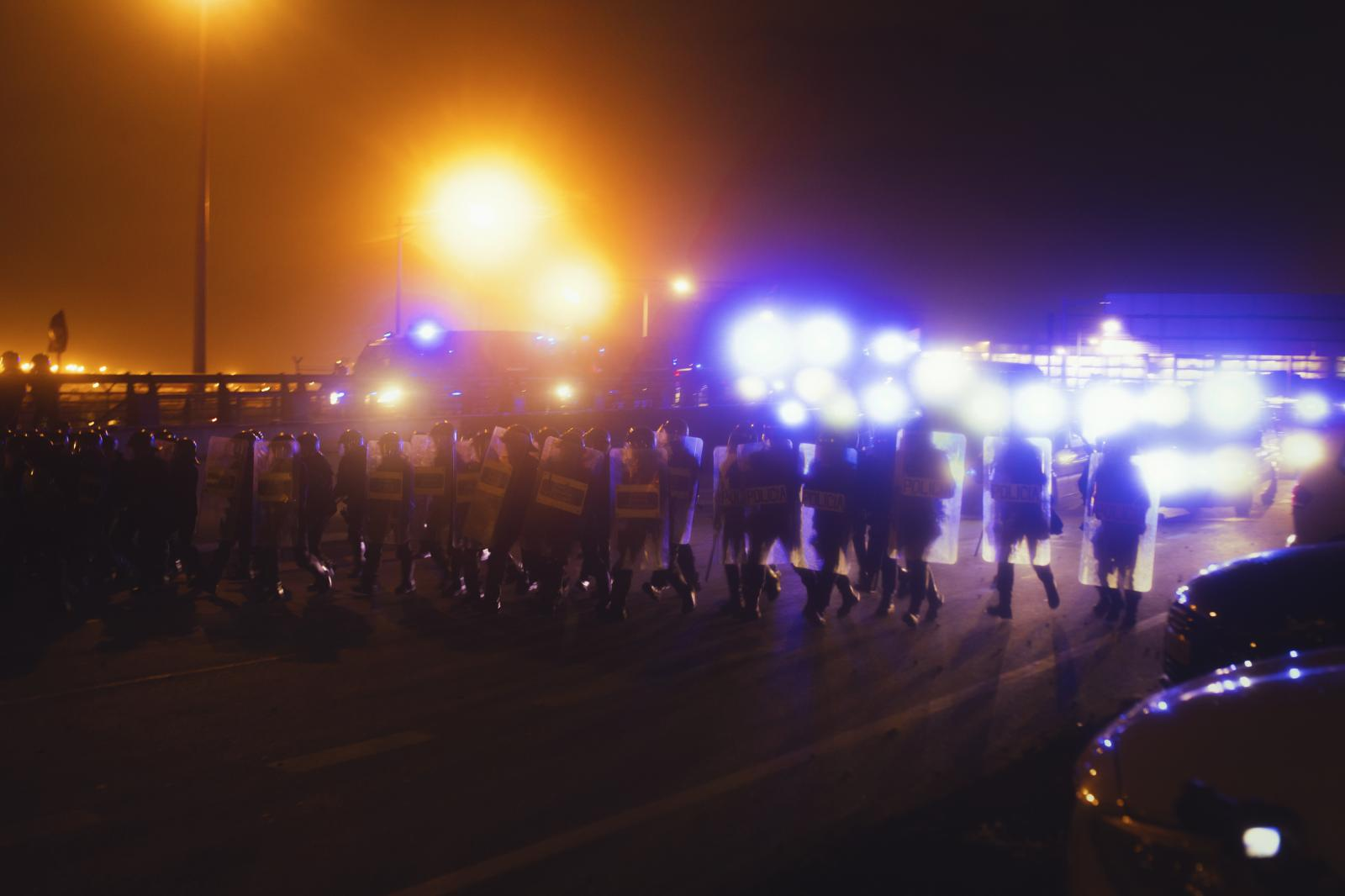 """Police intervention on the highway violently disperses a sit-in. Tsunami Democràtic cut off the main highway entry points into several big Catalan municipalities and several roads as a way to protest over leaders' jail sentences. During one of those mass march, people had been walking for three days to reach the Catalan capital in the so-called """"freedom marches."""" The highway, metro and train station were blocked off several times and mass protests were recorded also in the municipality of La Jonquera and in the border with France. Spanish and French police intervened on several occasions to remove road cuts, identify and arrest the perpetrators of sabotages and blocks. Drivers were also experiencing problems on the N-II, N-240, N-340 and N-420 national highways. (October 14,2019. Barcelona, Spain)"""