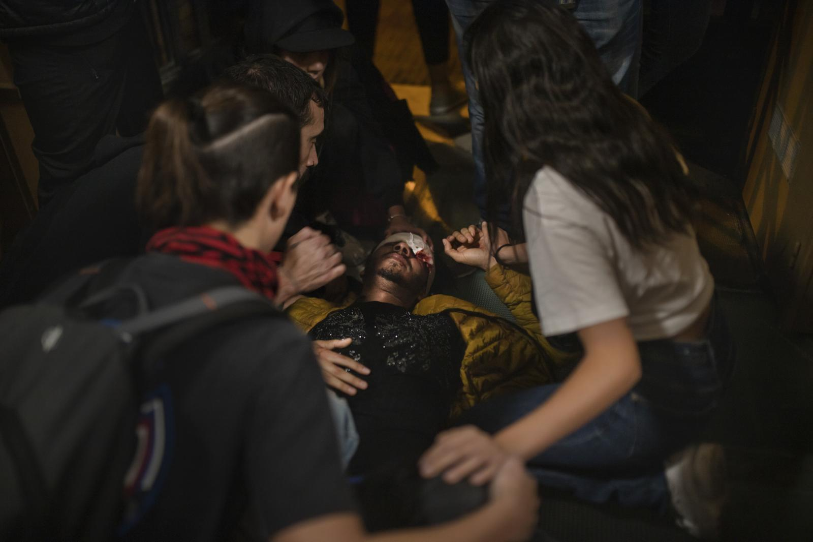 """A man is on the floor after being injured by the police. During protests in Catalonia, four people have lost sight in one eye, another lost testicular mass. Rights group Amnesty International called on """"all authorities"""" to refrain from contributing to the escalation of tensions in the streets and to respond """"proportionally"""" to outbreaks of violence. In 2014 a ban on the use of rubber bullets as an anti-riot weapon was imposed on the Catalan police force following a high profile campaign led by victims who had lost vision. Then armed guards of Mossos de Esquadra only used """"foam"""" bullet to control the altercations recorded in the Catalan streets, while National police and Guardia Civile used rubber bullets too because of """"a scale of order"""" and the rules that allow using this riot gear """"are above"""" what is established in the Catalan law. (October 18,2019. Barcelona, Spain)"""