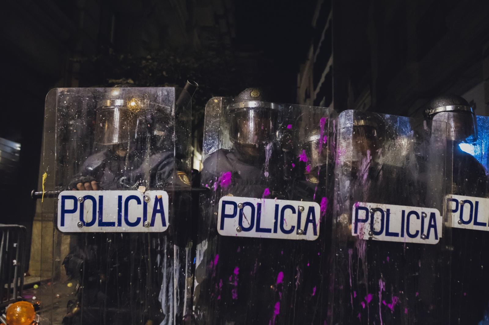 Riot police shelter themselves from balloons with colorful paint. The separatist movement is proud of its history of mostly peaceful campaigning. Officials have accused a relatively small number of agitators of provoking the recent riots. Spanish authorities suspect a secretive new group called Tsunami Democratic is using encrypted messages to orchestrate some of the attacks in the streets by using an app designed to expand and interact with a network of contacts that share the same QR code, to allow, to organize, promote and coordinate new actions and forms of protest. The group gained nearly 340,000 followers on its main channel in Telegram. A National Court judge ordered the closure of websites linked to the group. (October 26,2019. Barcelona, Spain)