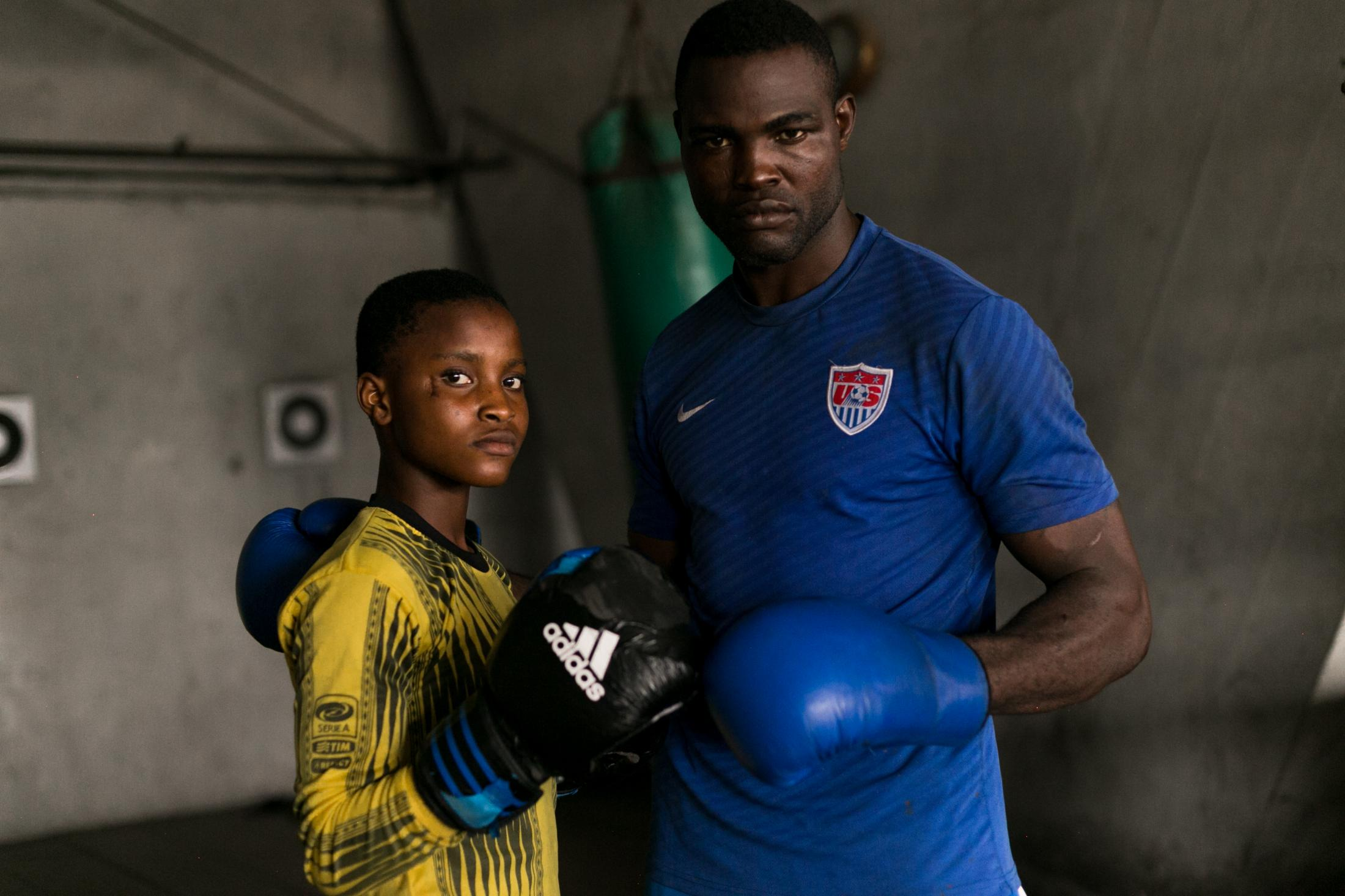11July 2019: Fatai brings his daughter Olamide, 15. along with him to train so that she can learn to defend herself, Lagos, Nigeria