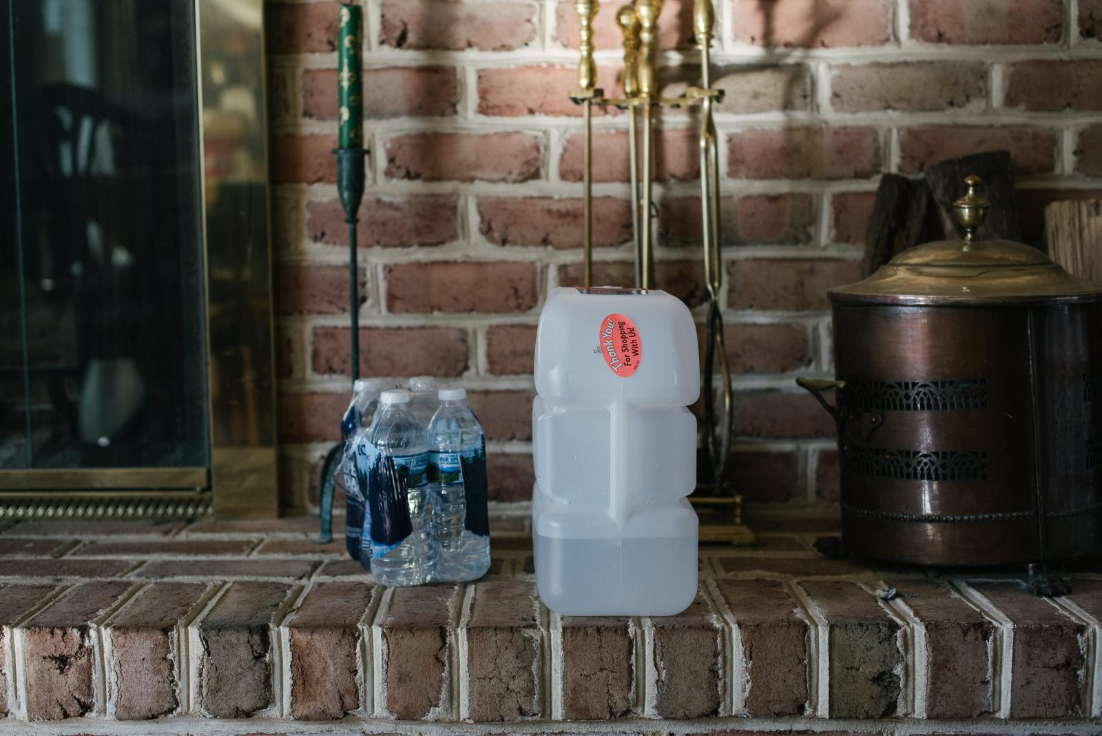 Water bottles sit in Rosemary Fuller�s home inside her living room at her home in Media, PA. on Thursday, January 16, 2020. Fuller believes her water has been contaminated due to the work being done by the Mariner East Pipeline near her home. Photo by Hannah Yoon