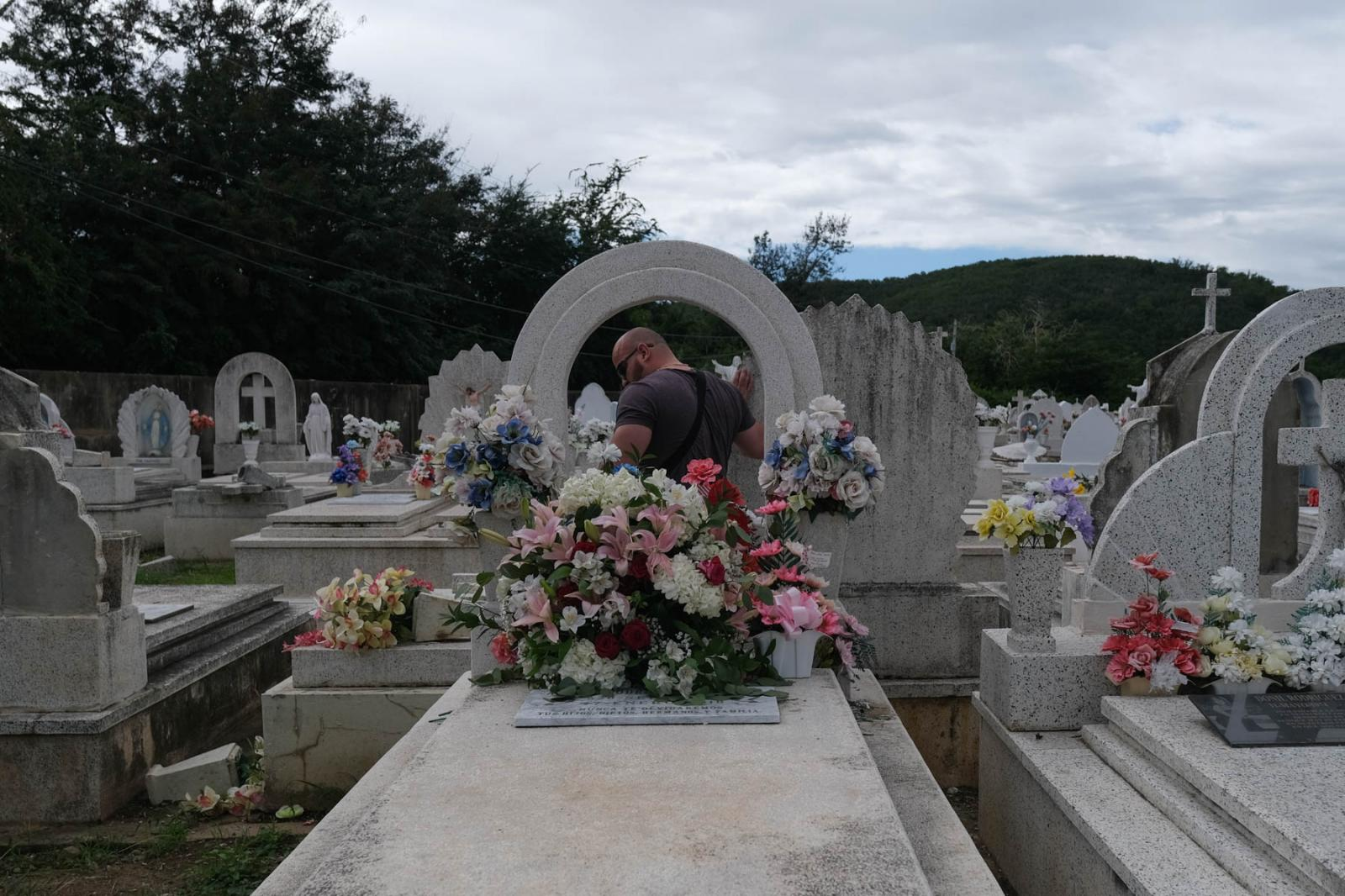 On the morning of January 7th, 2020, two earthquakes of 6.6 and 6.0 were reported in the southwestern region of Puerto Rico producing an island-wide blackout. Orven Velazquez, 39, based in New Jersey, despite the cementary being closed, takes flowers to his mother's grave. His mother Anail Rodriguez died two years ago after Hurricane María. Gabriella N. Báez for CNN.