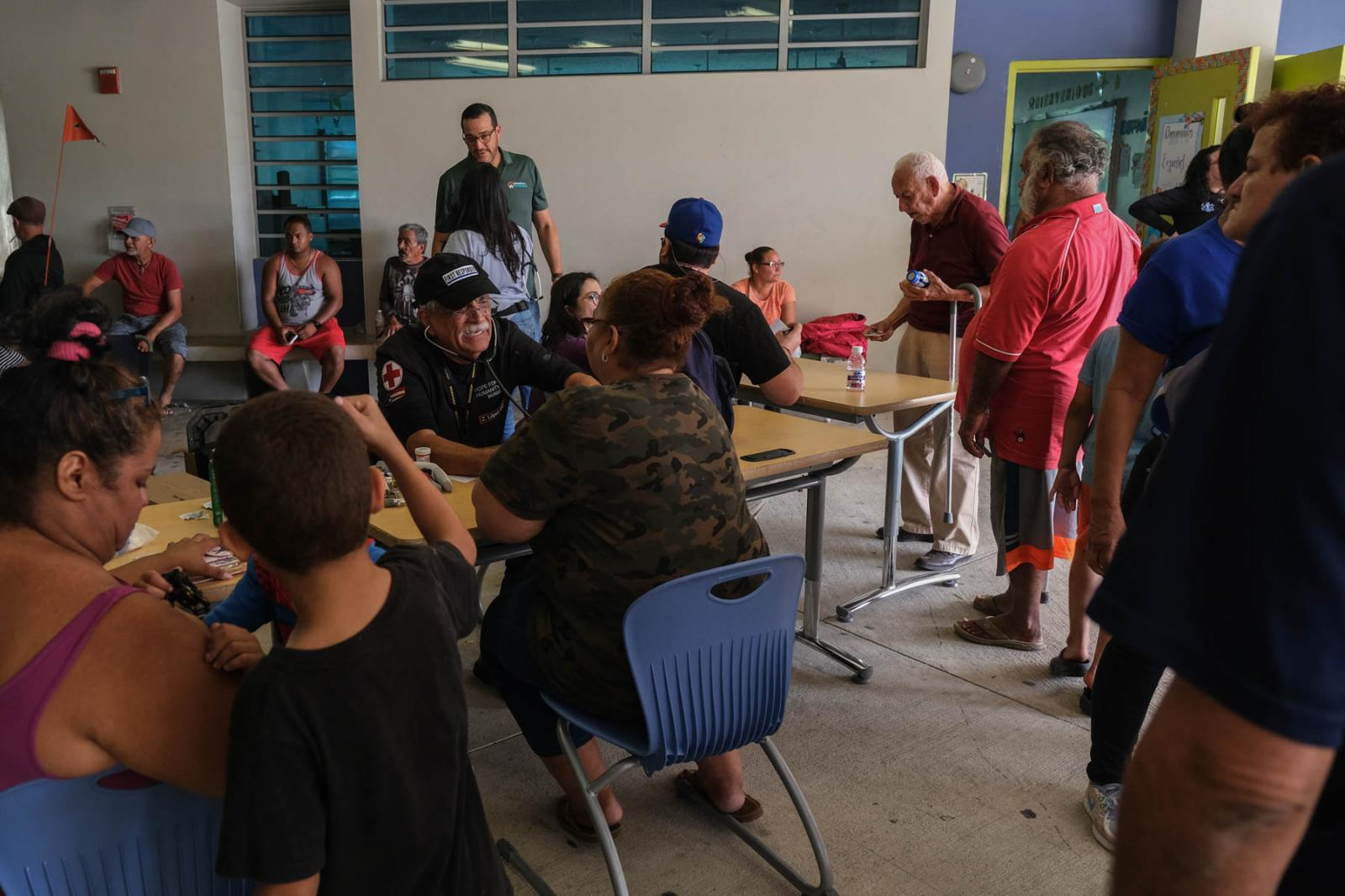 On the morning of January 7th, 2020, two earthquakes of 6.6 and 6.0 were reported in the southwestern region of Puerto Rico producing an island-wide blackout. Doctors and nurses attend the population of refugees in the Escuela Superior Bernardino Cordero Bernard. Gabriella N. Báez for CNN.