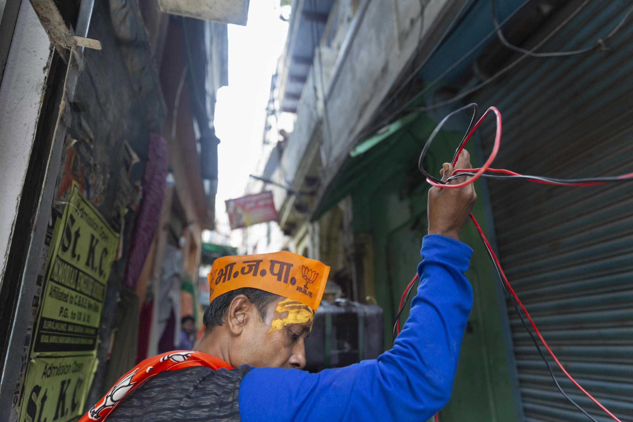 A BJP supporter sets up the music system before the Lok Sabha election results were disclosed.