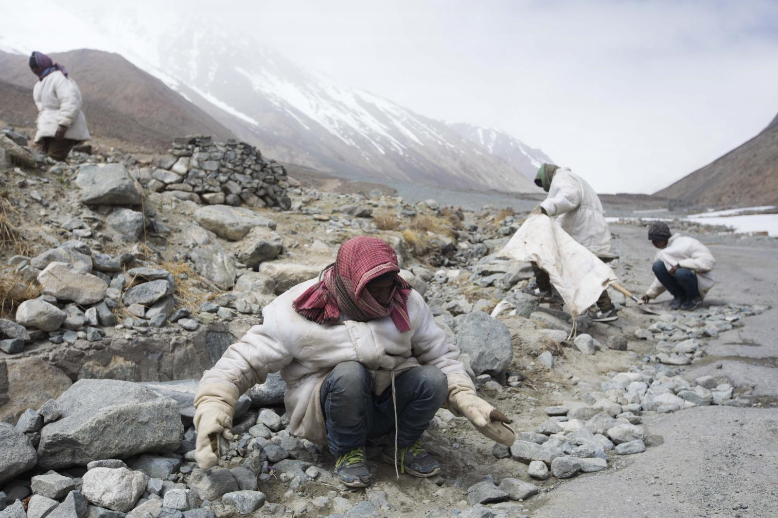 Road maintenance workers from India's low-lying eastern Jharkhand state work along Pangong Lake road in northern India's Ladakh region.