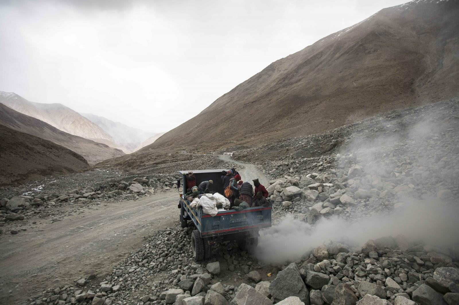 Road maintenance workers from Jharkhand state and Ladakh head back to their respective campsite and homes after a day's work along Pangong Lake road near the Chang La pass in northern India's Ladakh region.