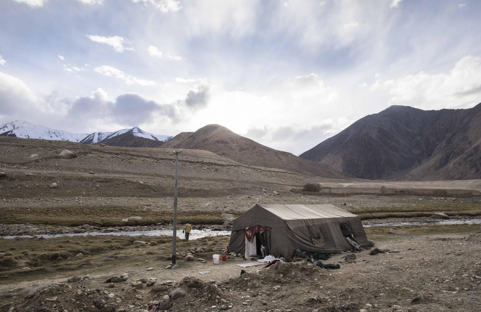 General view shows the campsite of road maintenance workers from India's low-lying eastern Jharkhand state, near Tangtse village in northern India's Ladakh region.