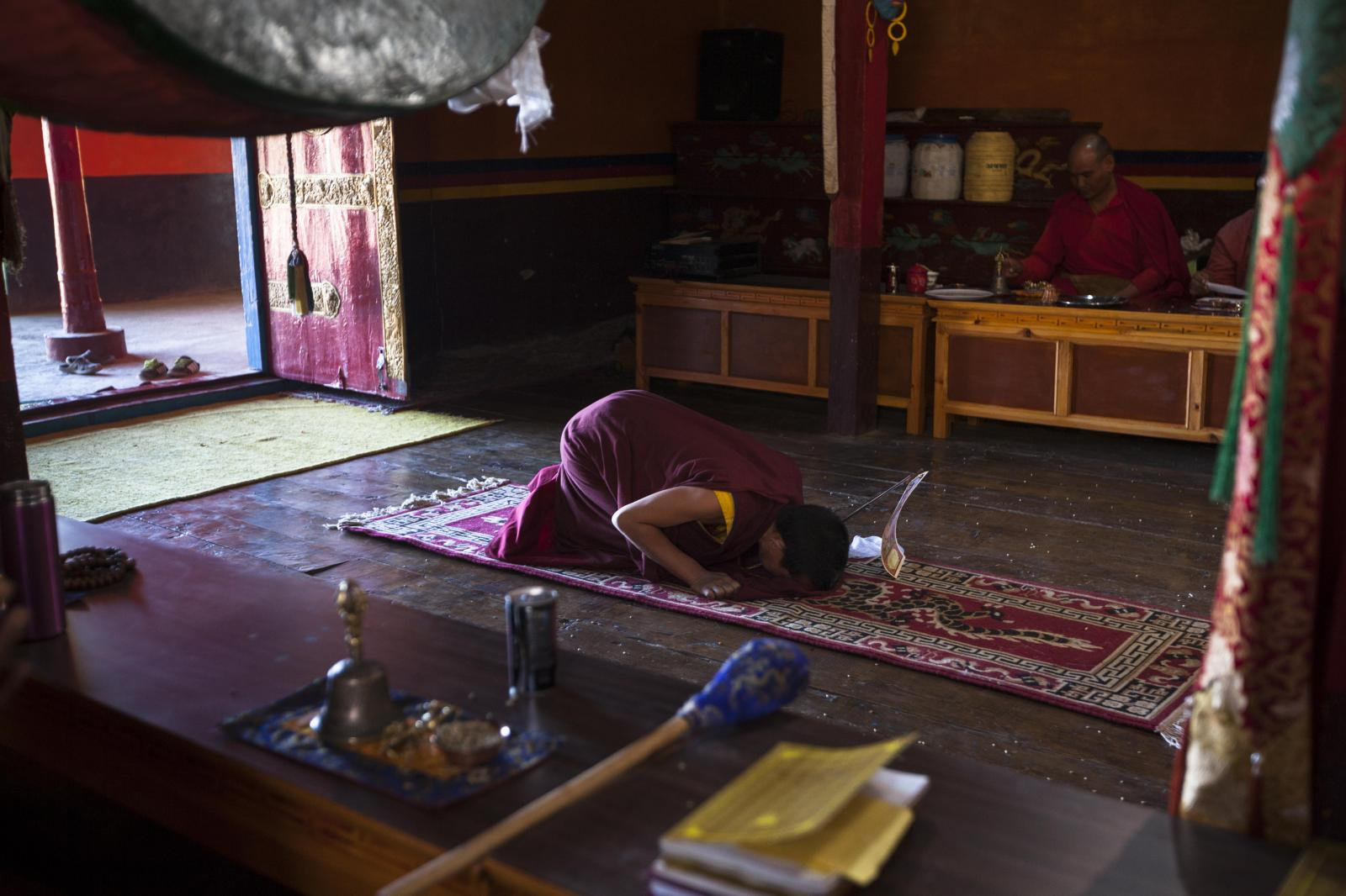 Buddhist monk Nawang Jinpa, 30, prostrates at the prayer hall during a 'puja' at Tnagyud Gompa monastery in Komik village, in Spiti Valley of the Indian northern state of Himachal Pradesh.