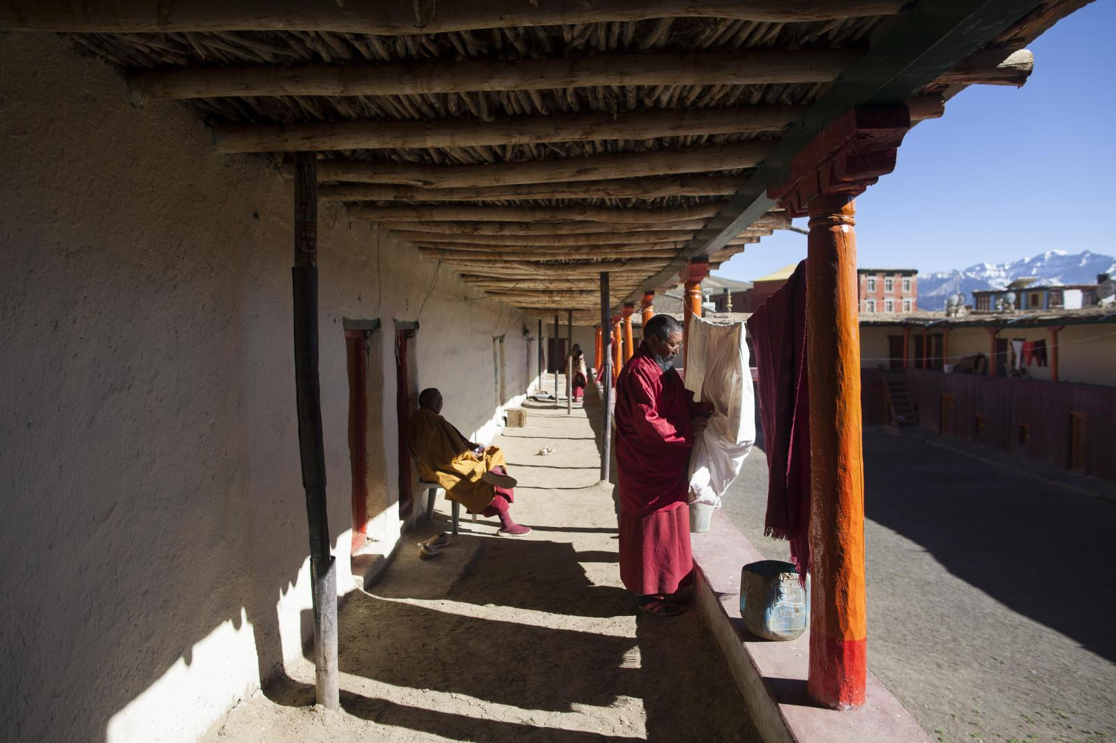 Buddhist monks Nawang Tashi (R), 53, and Nawang Lodoe, 49, rest after the afternoon 'puja' at Tnagyud Gompa monastery in Komik village, in Spiti Valley of the Indian northern state of Himachal Pradesh.