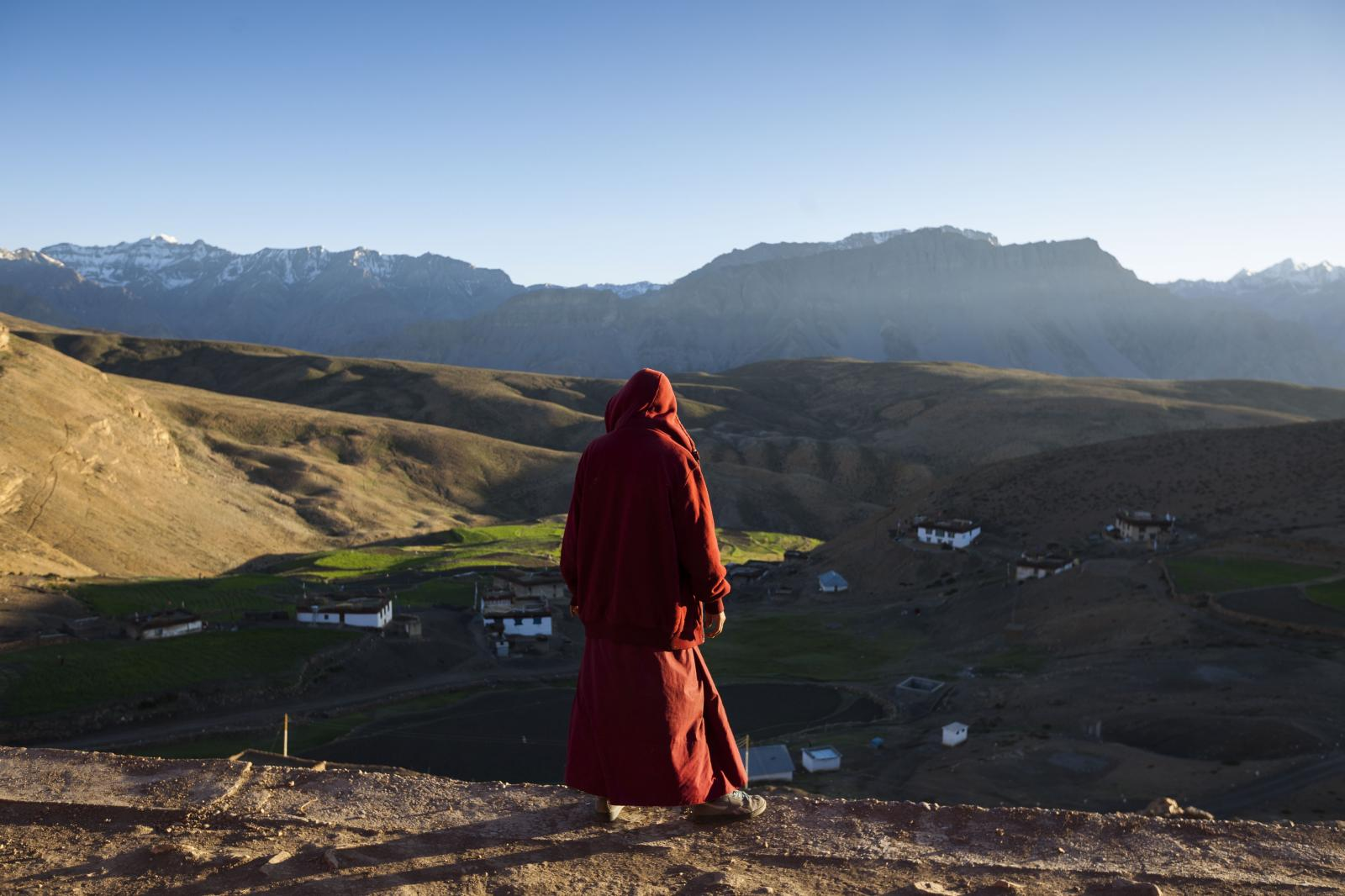 Buddhist monk Nyima Kungha, 39, looks out from Tnagyud Gompa monastery as the sun sets in Komik village, in Spiti Valley of the Indian northern state of Himachal Pradesh.