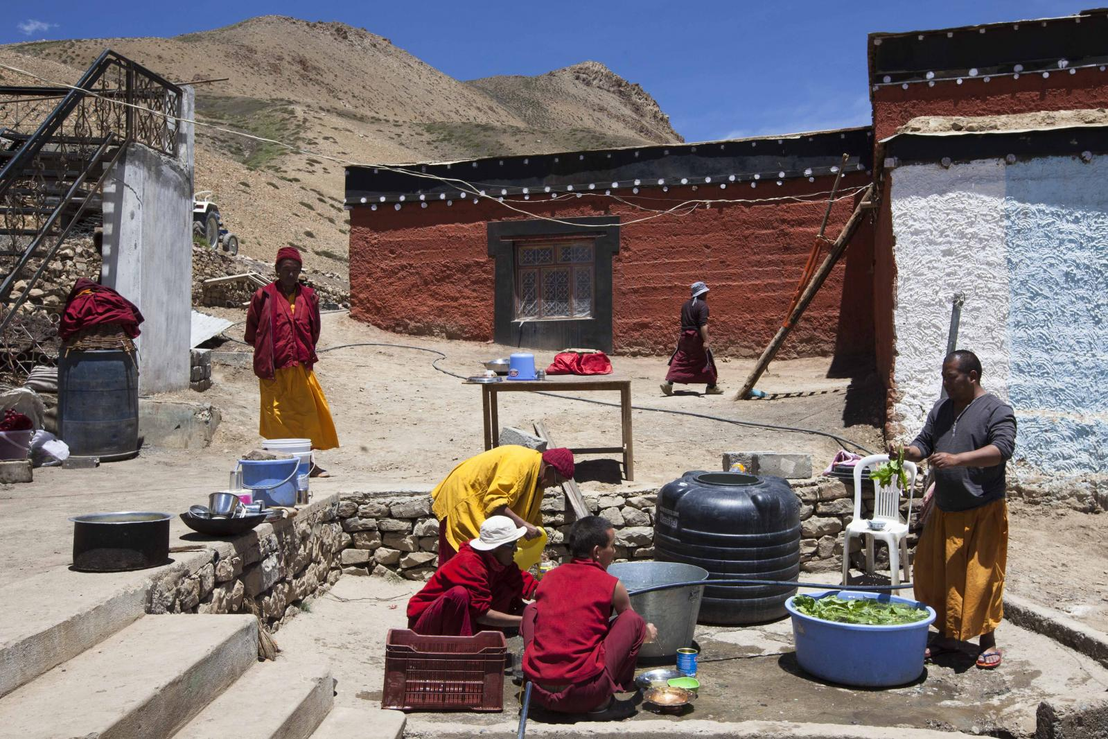 Buddhist monks carry out daily chores at Tnagyud Gompa monastery in Komik village, in Spiti Valley of the Indian northern state of Himachal Pradesh.