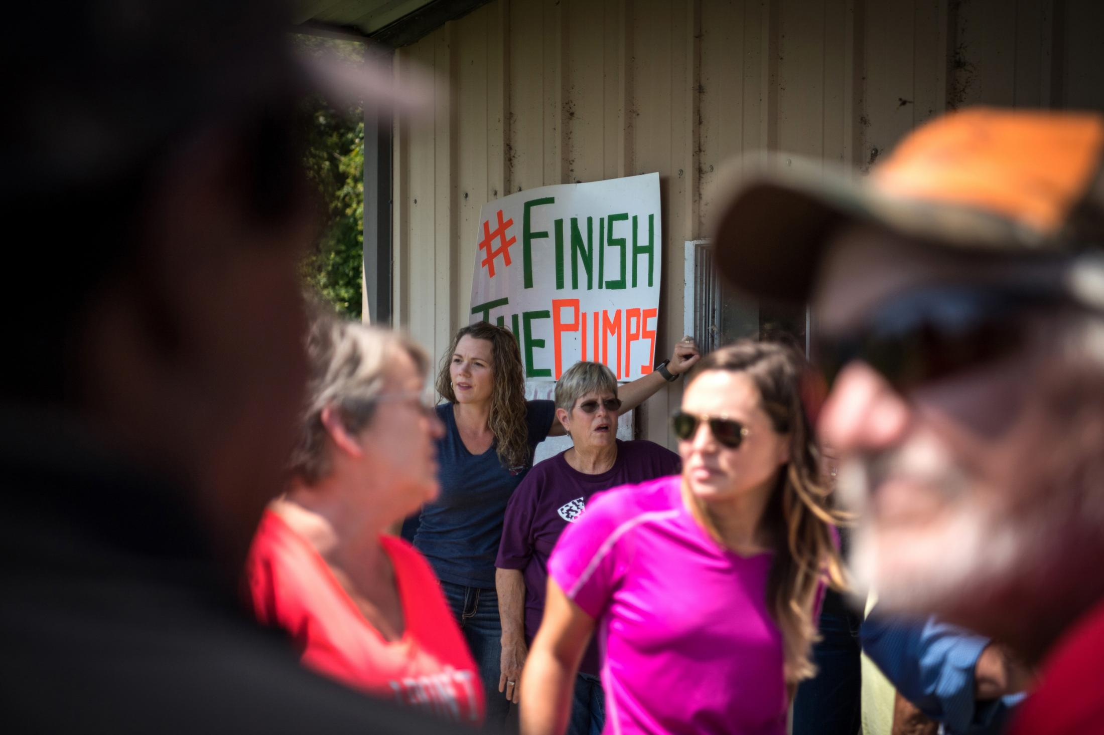 Regional residents gather outside the Valley Park fire station following a media day meeting in Valley Park, Mississippi on July 27, 2019. Updates about recovery relief were provided by local officials and the Mississippi Levee Board. Photo by Rory Doyle for The Guardian.