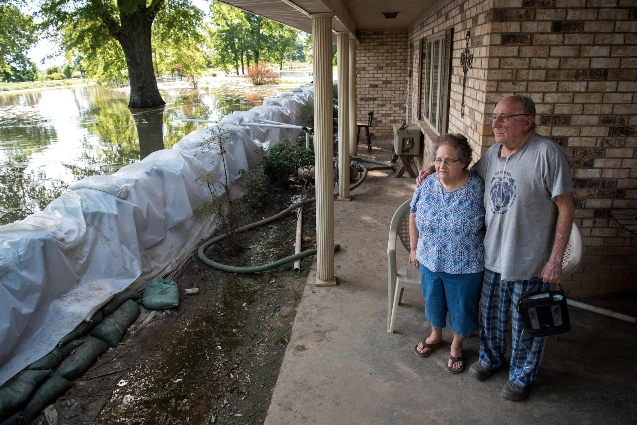 Barbara Browning, 74, poses for a portrait with her husband Norman Browning, 77, at their home in Valley Park, Mississippi June 14, 2019. A levee was constructed around their house to keep the backwater out, and the couple have barely left their home since the flooding began in February. Members of their family check on them daily.