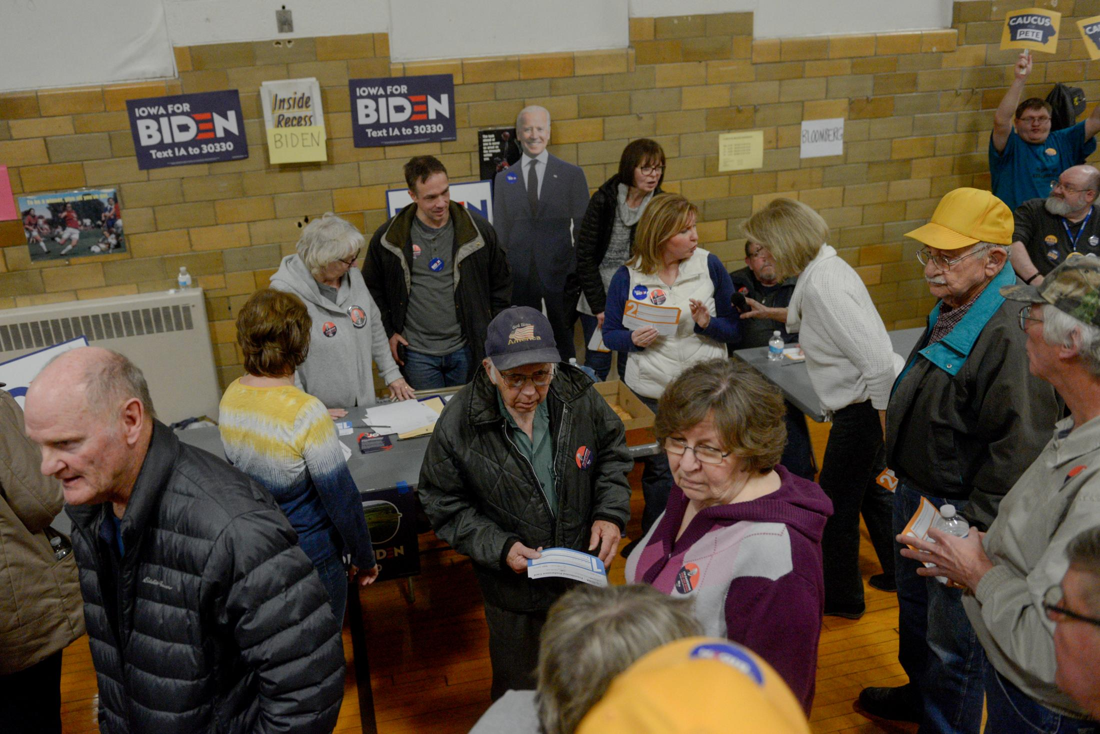 Supporters of Joe Biden stand around their table at Richardson Elementary School for the Fifth Precinct caucus on Monday, February 3, 2020, in Fort Madison, Iowa. The Biden campaign received three delegates from the district.