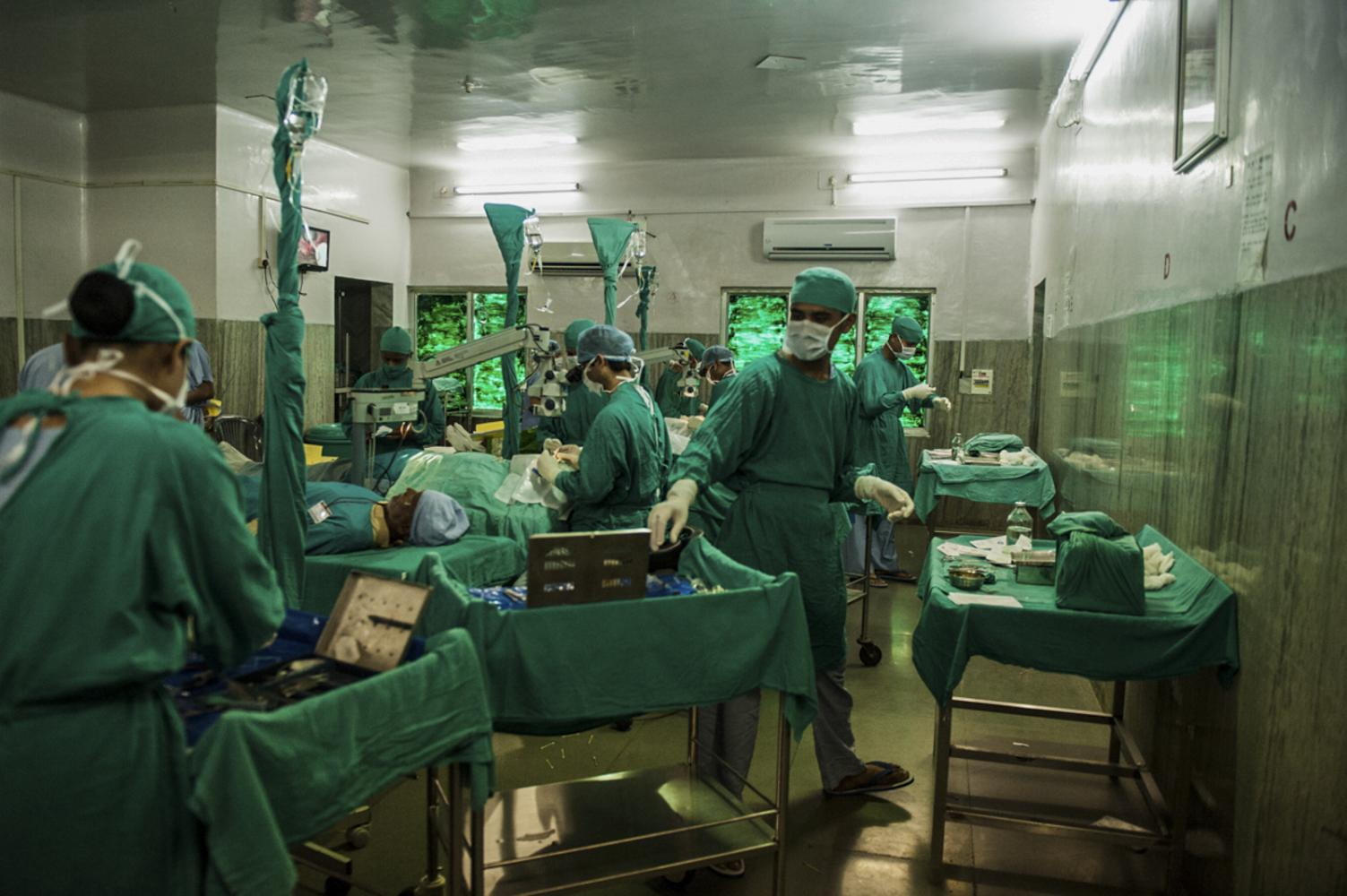 Inside one of the five operating theatres multiple patients can by operated on at the same time. Patients are awake and able to walk both pre and post operation. Chitrakoot, India.