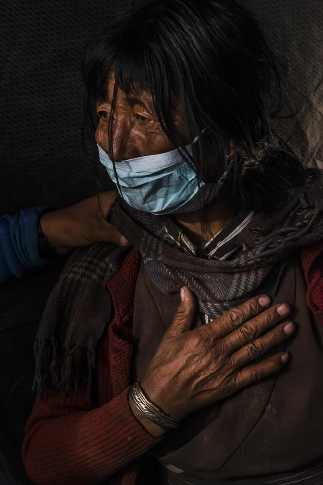 A woman visits a medical clinic in Dho Tarap, Nepal to see an Amchi. An Amchi (Tibetan medicine man) tends to the spirit of the person before the disease. Amchis believe that if the person is not heard, understood and cared for then they cannot cure them.