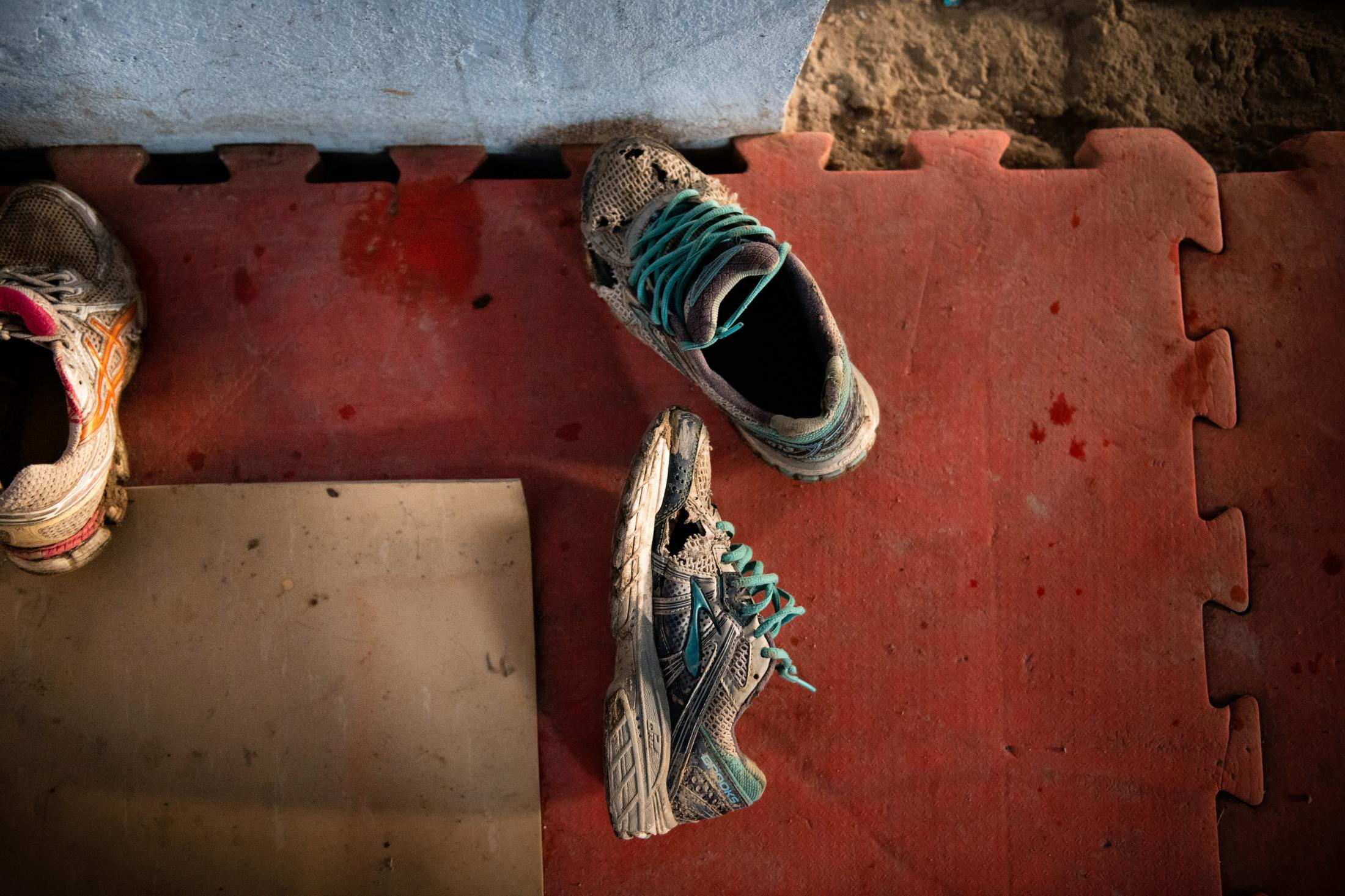 KABUL | AFGHANISTAN | 2/6/19 | Shoes belonging to one of the member of Maiwand Wrestling Club. On Sept. 5, an Islamic State suicide bomber looking for Shiites to kill, burst in and took the lives of as many as 30 people at the club. Despite the attack, everyday, over 100 members, as young as 9 year old, come together to practice inside Maiwand Club. Kiana Hayeri for The New York Times