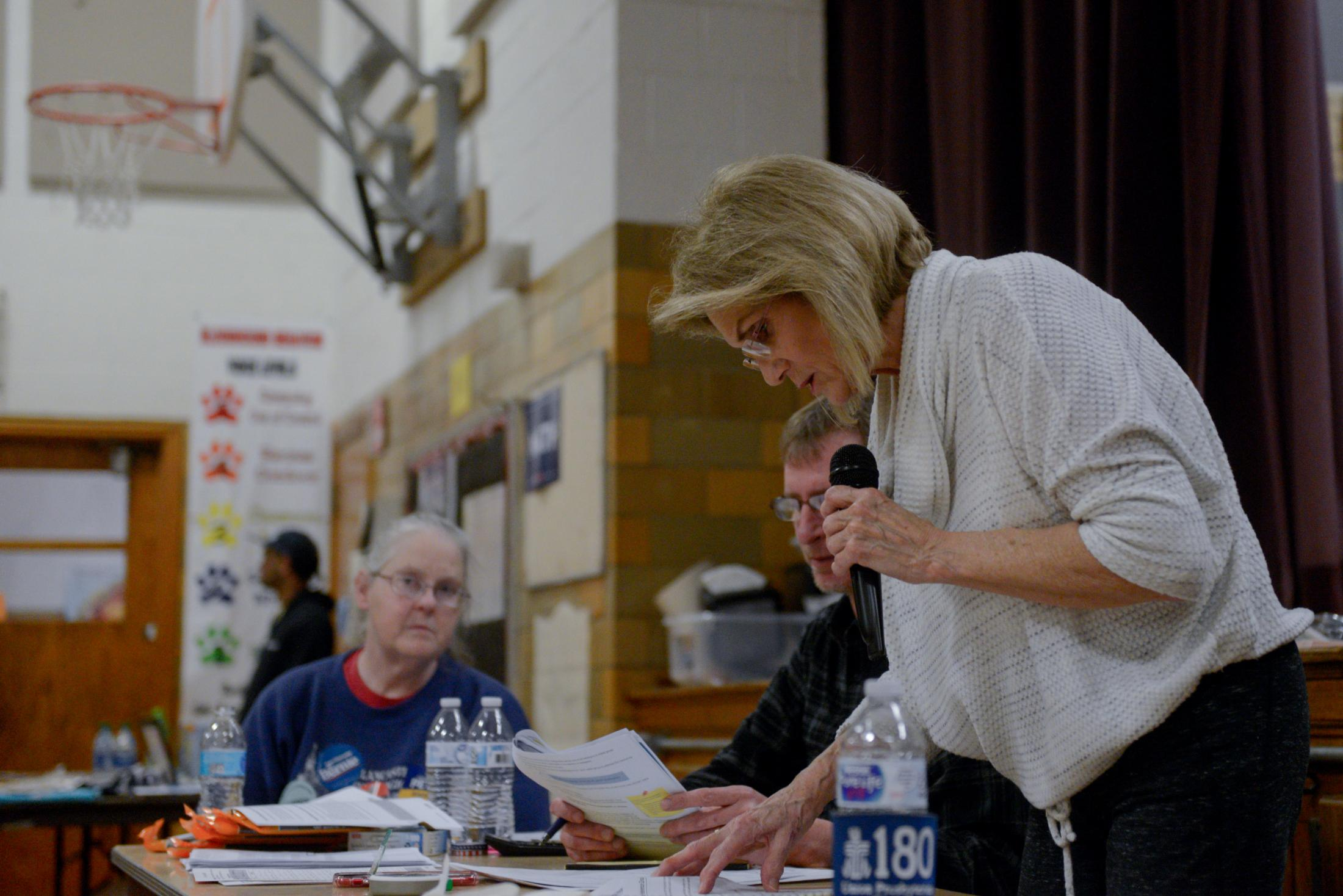 Precinct Chair Anne Pederson reads off which democratic presidential candidates still have viability at Richardson Elementary School for the Fifth Precinct caucus on Monday, February 3, 2020, in Fort Madison, Iowa. If a candidate does not have at least 15 percent of the votes in a caucus they lose viability and their voters can move to another choice.
