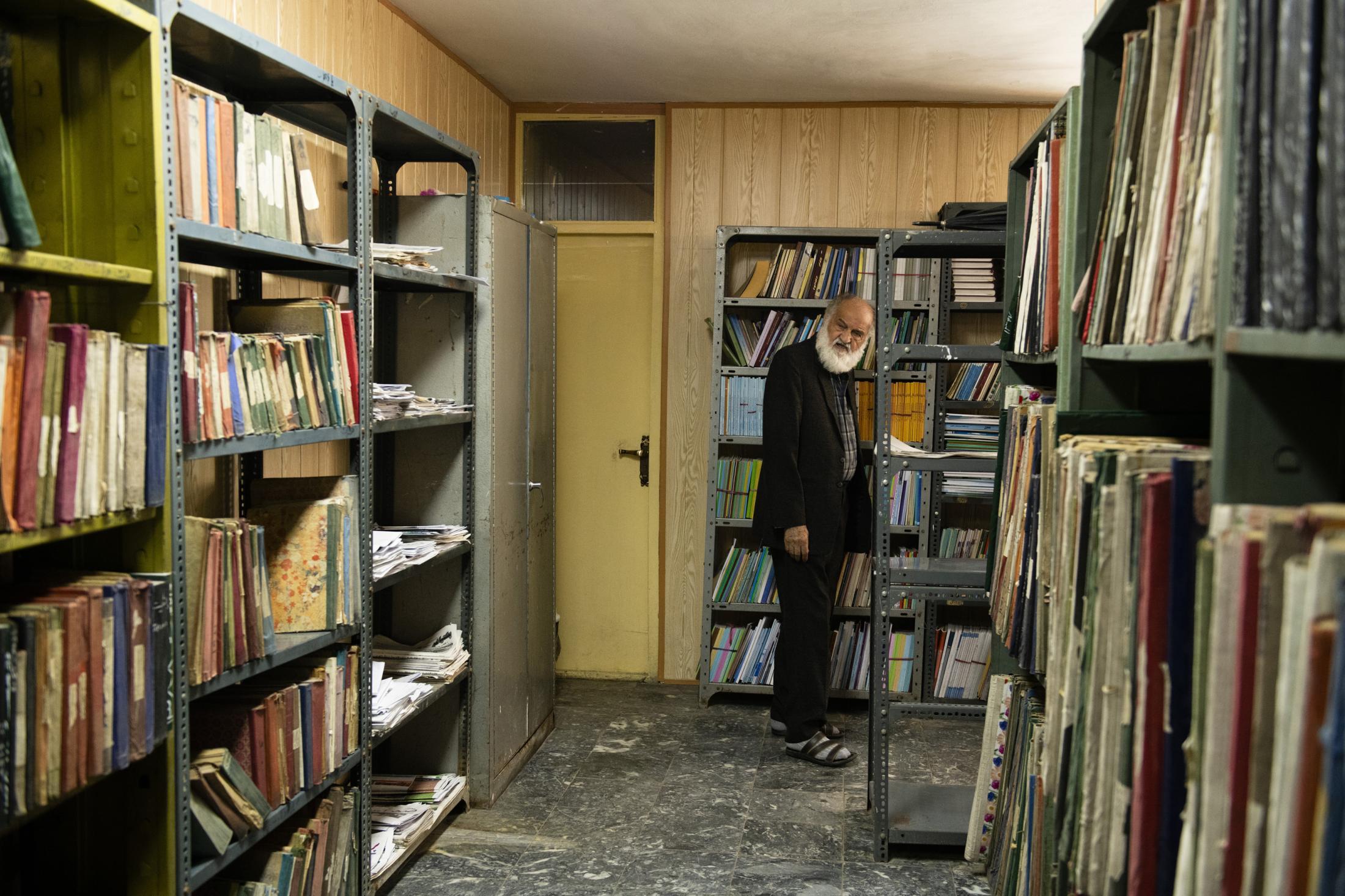KABUL | | 10/16/19 | Haidari Wojoodi (80) walks back to his desk after he walked out one of his visitors.
