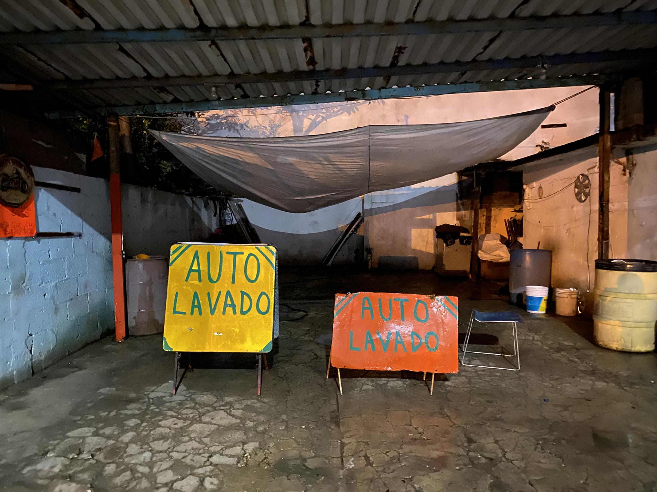 Altamira, Tamaulipas, México. 2020. Signs offering car wash services to the public. They're always outwhen I am walking back from my evening classes to the bus stop.