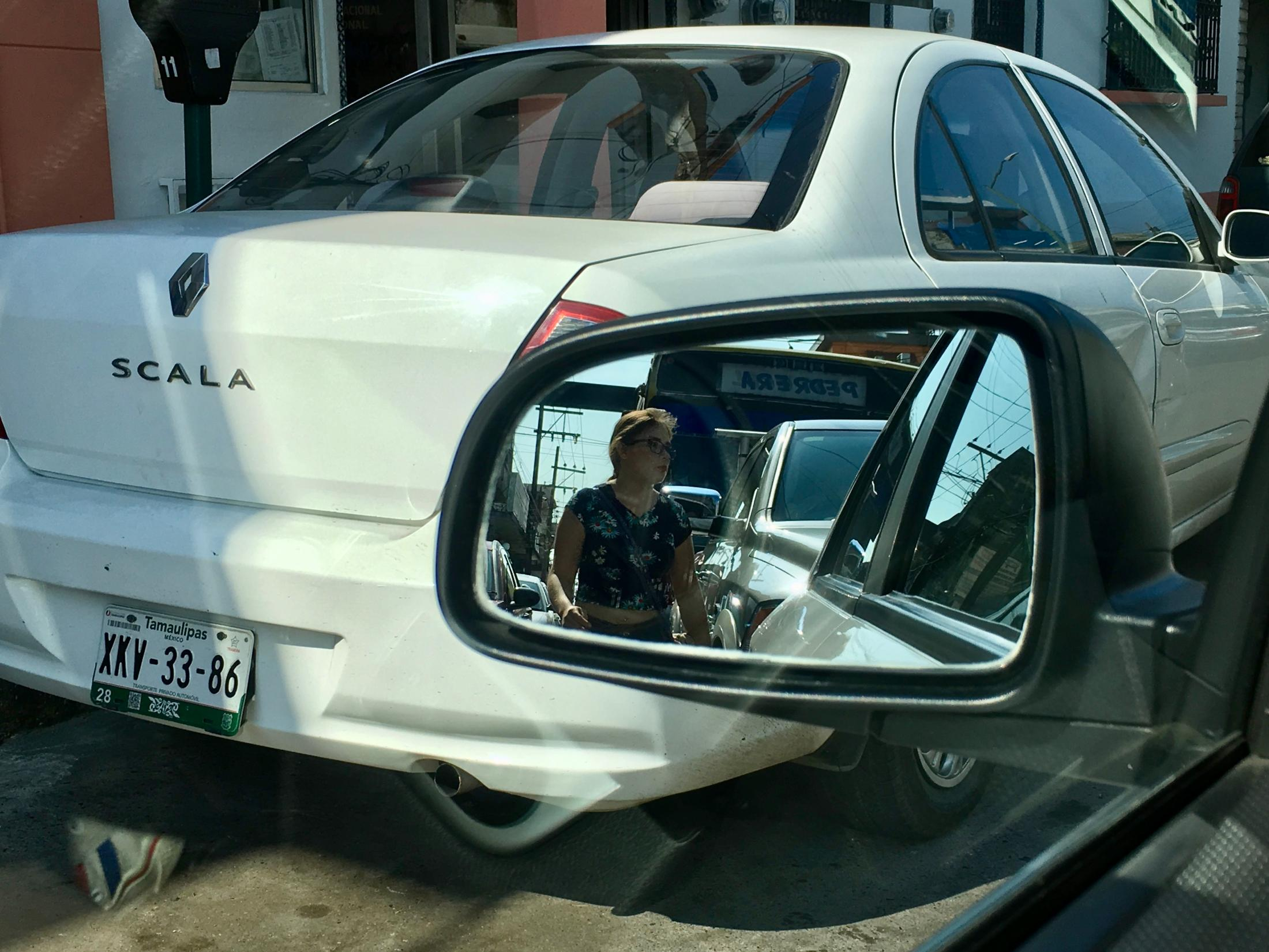 Tampico, Tamaulipas México. 2017. View of a lady from a car's rearview mirror. I was driving to sightsee the downtown area with my parents and grandmother.