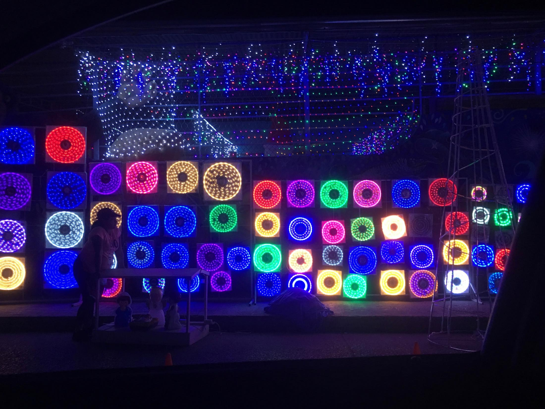 Tampico, Tamaulipas México. 2018. A store's exteriorfilled with cheap and colorful Christmas lights for sale,allowing customers to easily compare all options side to side . It is common to see these decorated walls outside of specialty stores, they are usually found in thedowntown area of Mexican cities. I had picked up my mother at the bus station that night. On our way home we saw many bright lights coming from a street. We followed themto find out what they were.