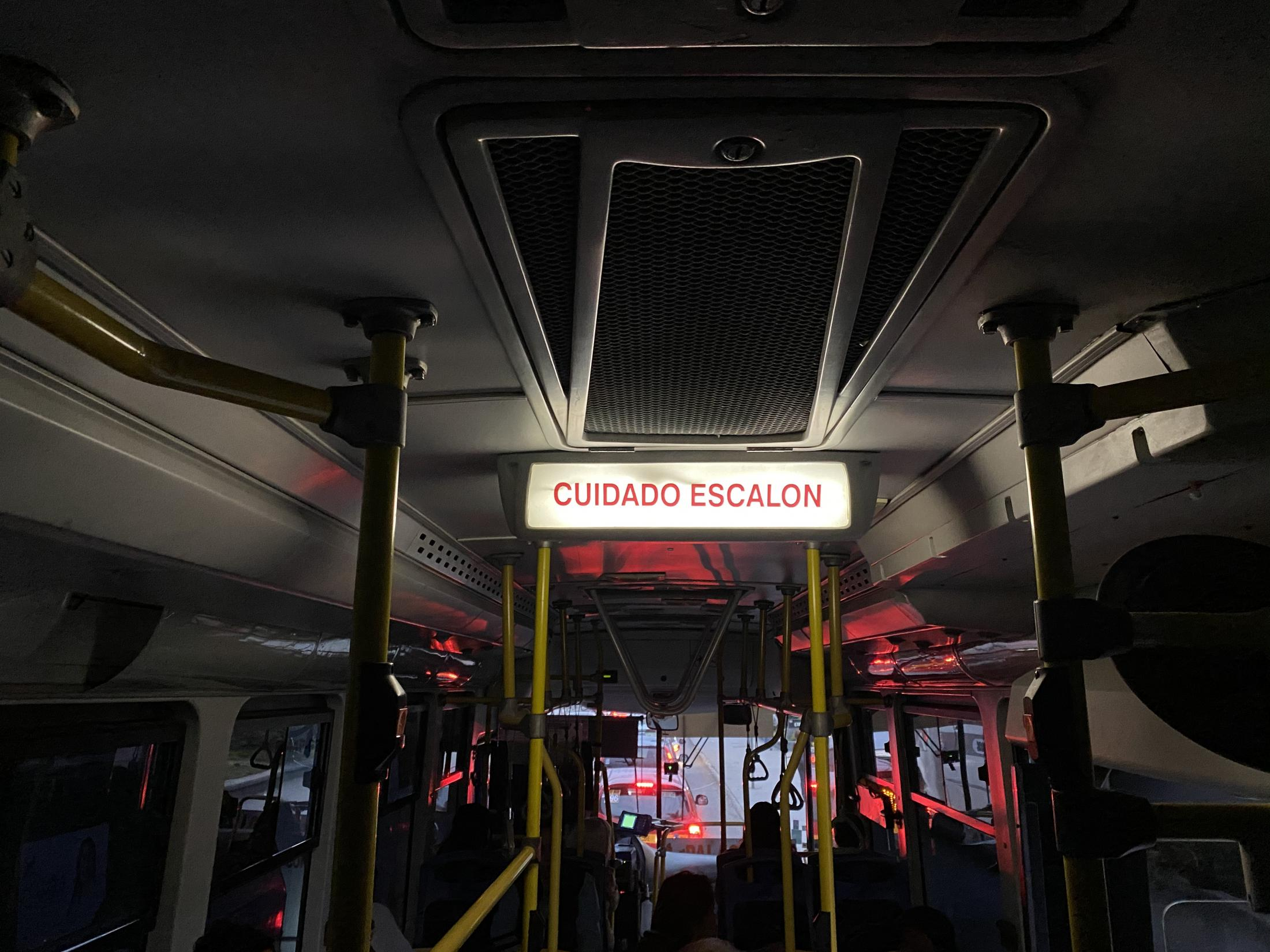 Tampico, Tamaulipas México. 2020. Illuminated bus sign warning passengers to be careful with a stair. I was on my way to fix problems and comfort someone very dear to me. It was a frustrating day.