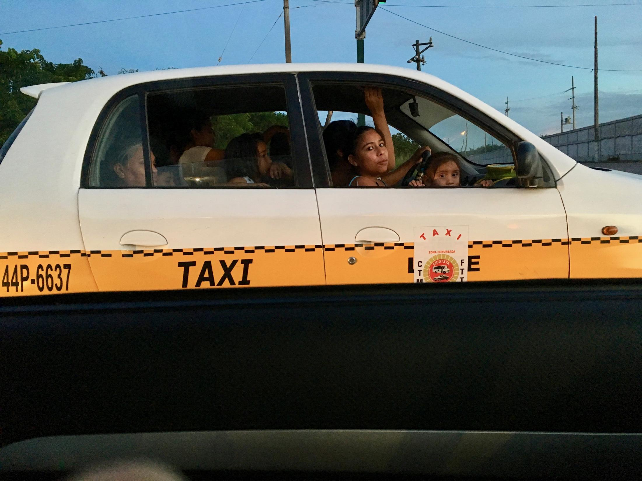 Ciudad Madero, Tamaulipas, México. 2016. Lady and child looking outside their taxi's window. I had gone to the beach with my parents and grandmother.