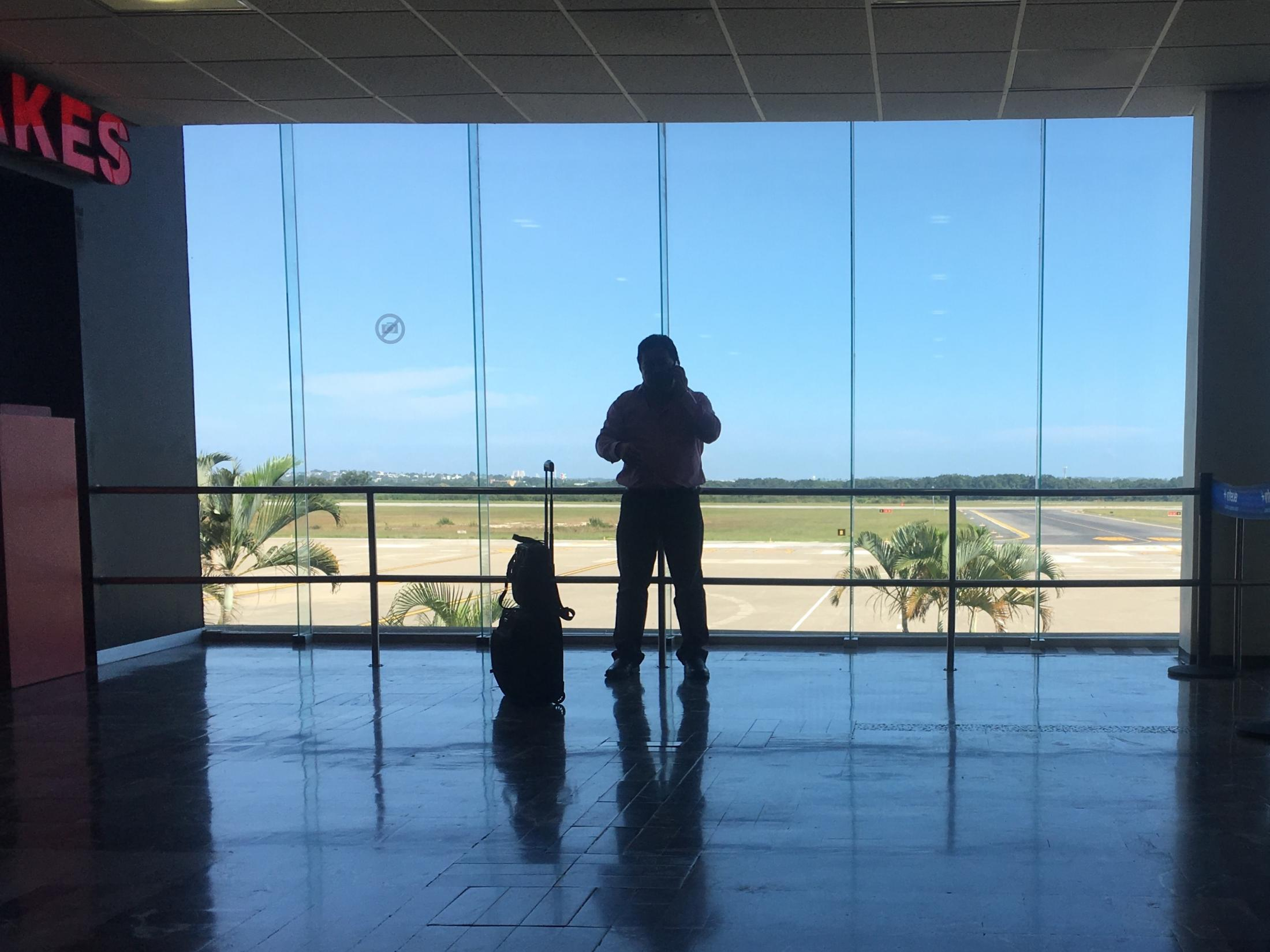 Tampico, Tamaulipas México. 2016 A man waits to enter terminal to board his flight at the airport. I was waiting to board a flight as well.