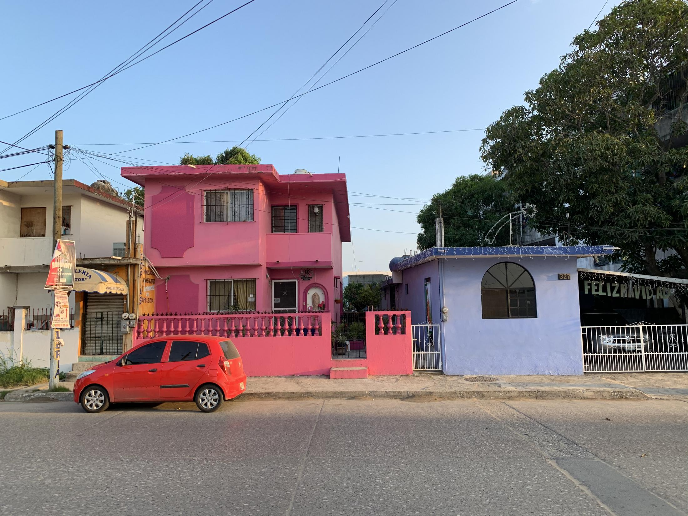 Ciudad Madero, Tamaulipas, México. 2019. Two colorful houses sit next to each other. These sort of hours are common in Mexico. I always see them on my way home coming from my girlfriend's house.