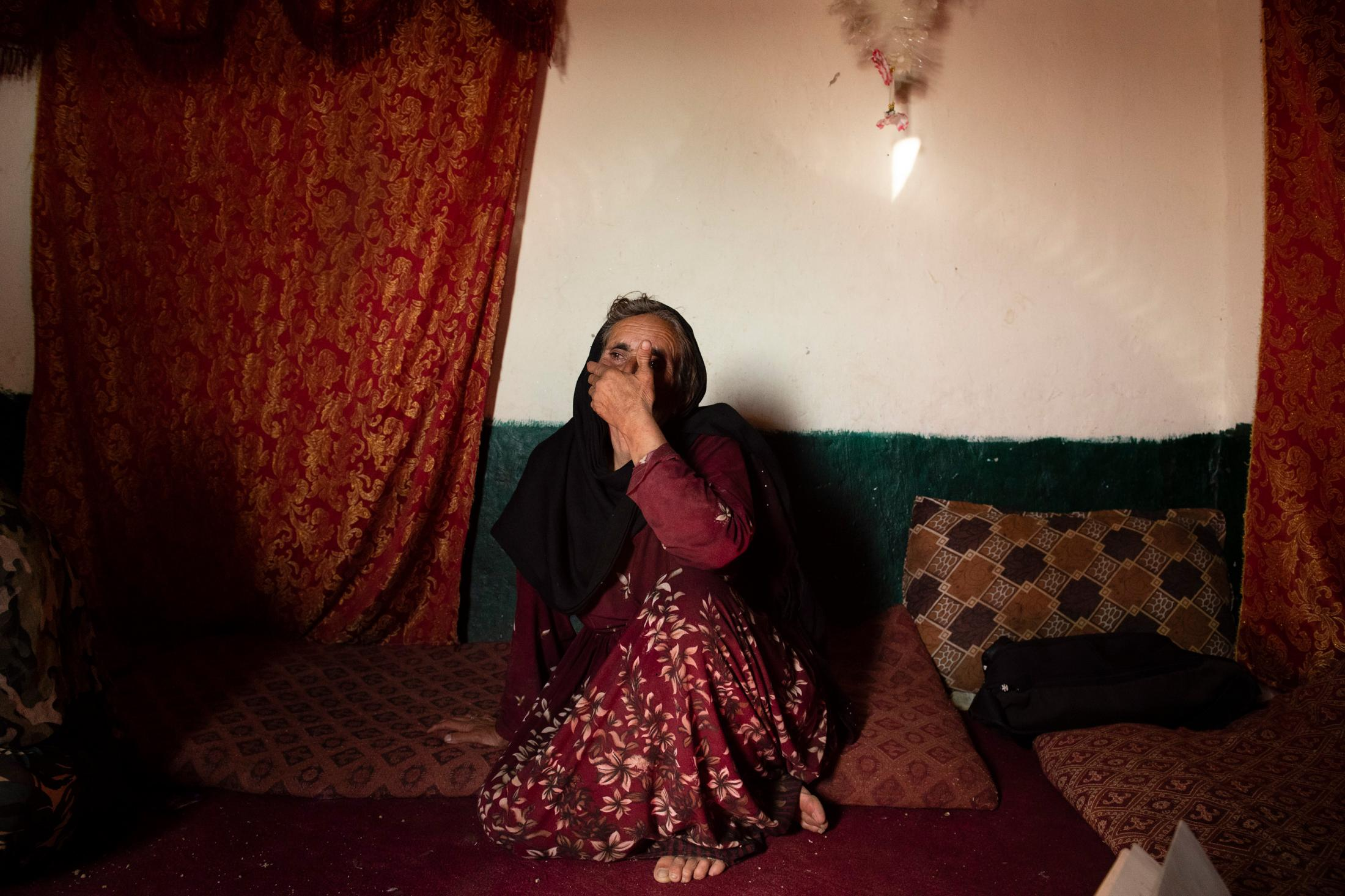 DOAGU VILLAGE   AFGHANISTAN   8/27/18   Aziza, in her 60s, mother of Amanat Khan (27) breaks into tear every time the name of her son is brought up. He ANP officer, was shot in fightings against Taliban in Niazi Village, not too far from their home village. He is survived by his wife and their four children, the youngest being 46 days old, who was orphaned before she was even born. Kiana Hayeri for the New York Times