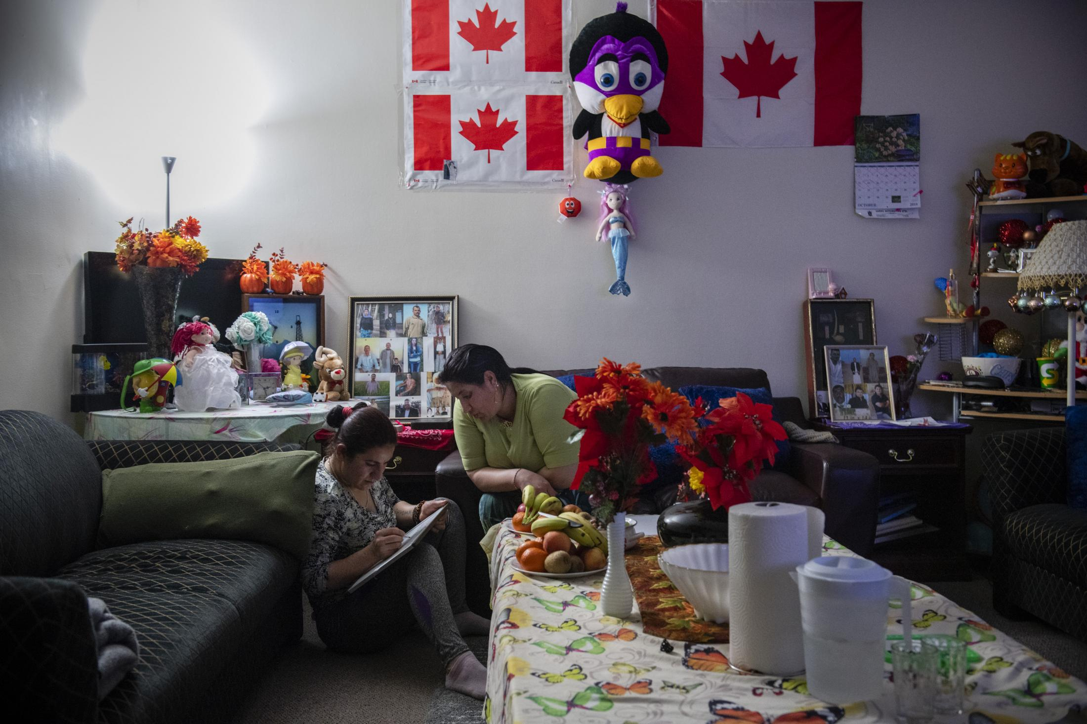 CALGARY | CANADA | 10/17/18 | Jihan (29) and Munifa (24) practice their english alphabet and numbers on a small portable whiteboard in the evening. Jihan and Munifa are Yazidi refugees living in Calgary, arriving in Canada during the summer of 2017 as part of the Victims of Daesh program, a special resettlement program created by the Canadian government to help Yazidi refugees.