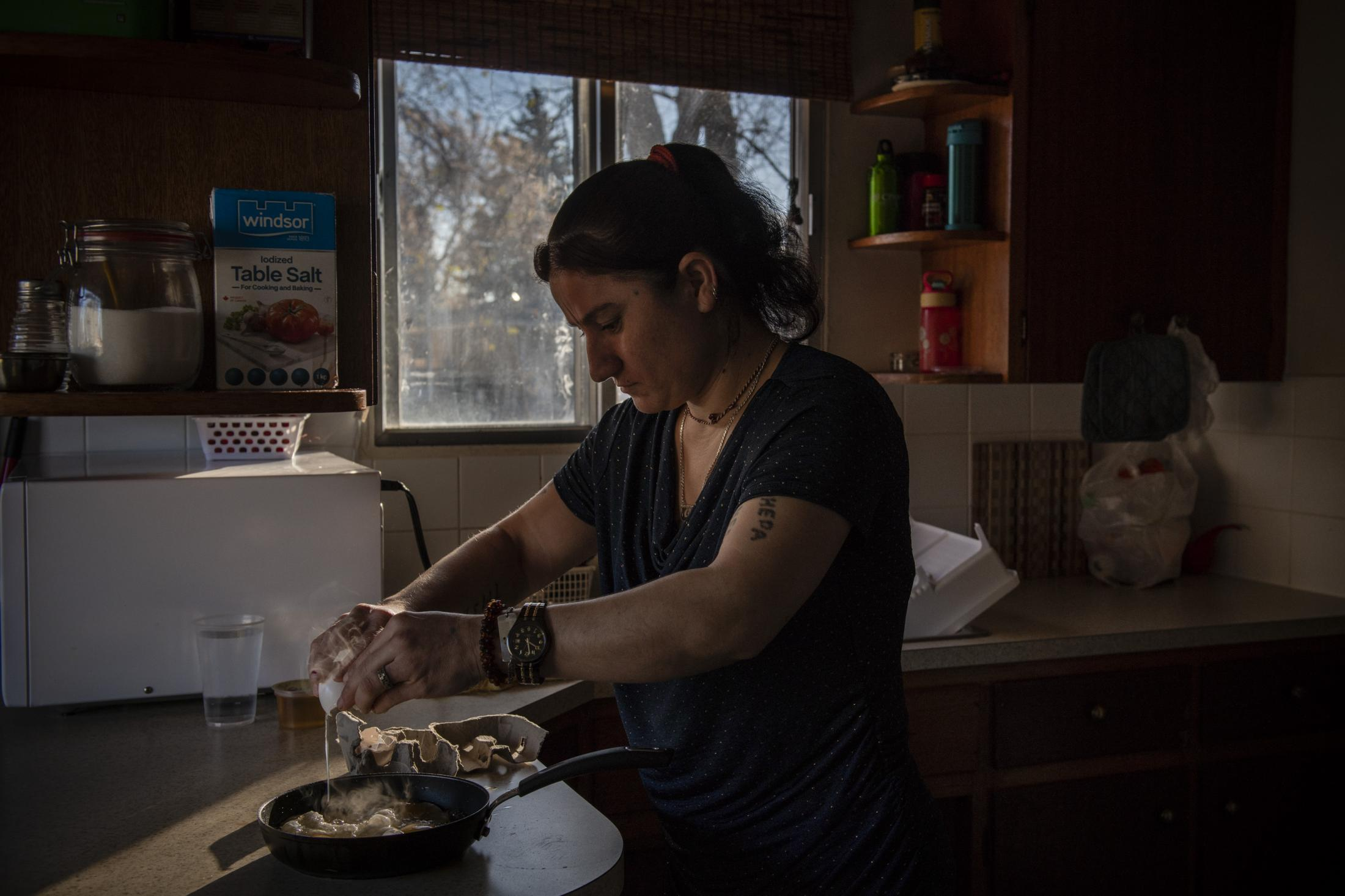 CALGARY | CANADA | 10/17/18 | Jihan (29) prepares breakfast for herself and her sister. She does most of the house work and cooking in the house single handedly despite her condition. The two sisters are Yazidi refugees living in Calgary, arriving in Canada during the summer of 2017 as part of the Victims of Daesh program, a special resettlement program created by the Canadian government to help Yazidi refugees.