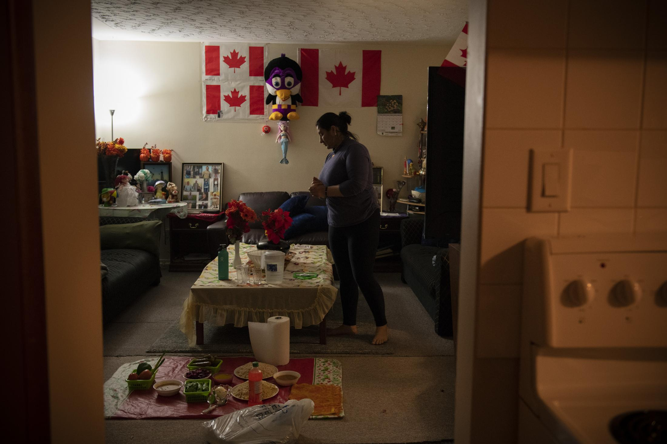 CALGARY | CANADA | 10/18/18 | Munifa (24) sets out the dinner in the living room of the house she shares with her sister in welters Calgary.