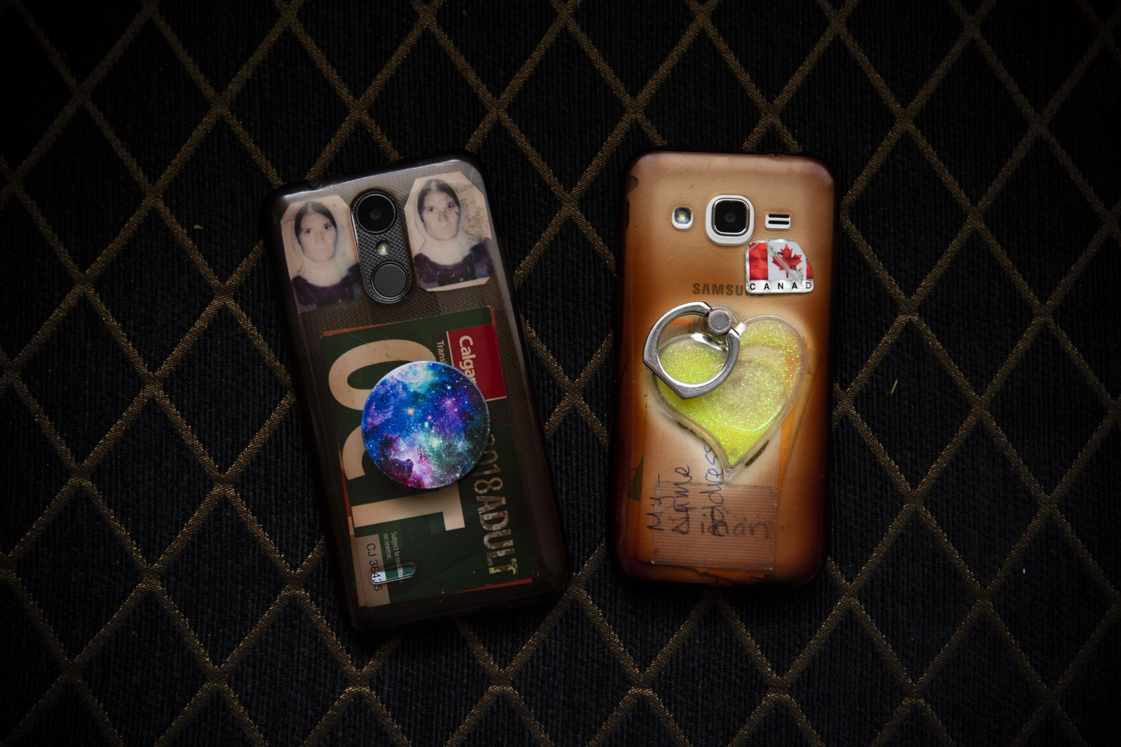 CALGARY | CANADA | 10/19/18 | Jihan's phone on the right with a sticker of Canadian flag and Munifa's phone on the left with two photos of her mother, stuck in between her phone and its transparent protective cover.