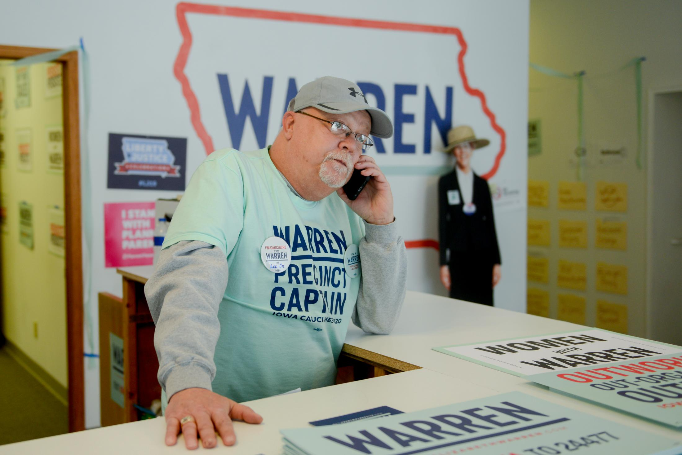 "Joel Amandus of Fort Madison answers his phone at the Elizabeth Warren presidential campaign office on the day of the Iowa caucus Monday, February 3, 2020, in Fort Madison, Iowa. ""I think it's time for a woman to run the country,"" Amandus said about why he was campaigning for Warren."